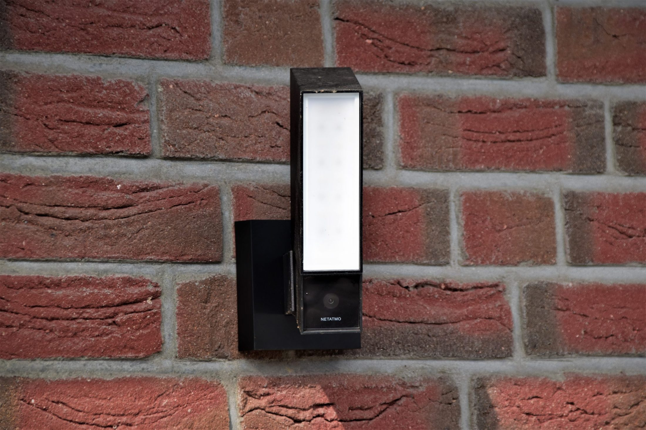 black and white wall mounted device
