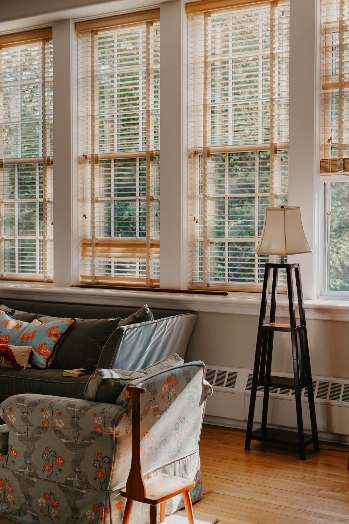 black and white floor lamp near white and brown wooden window frames