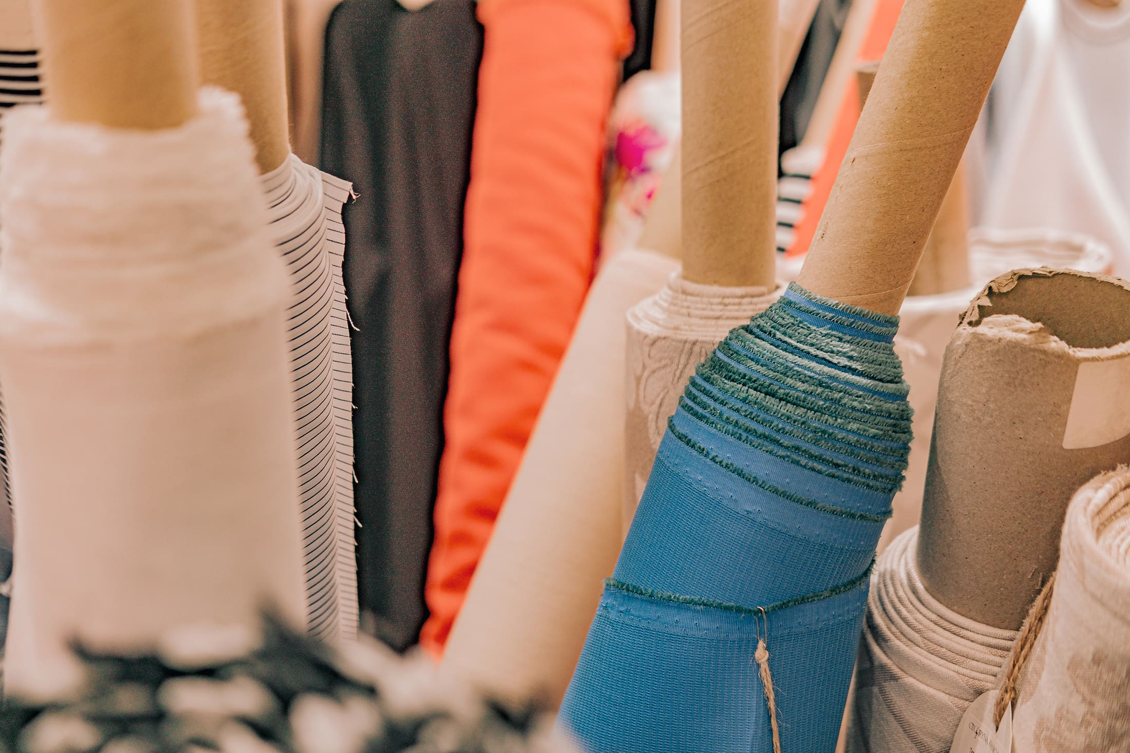 rolls of natural fashion fabrics and textiles 9EFTPJ7
