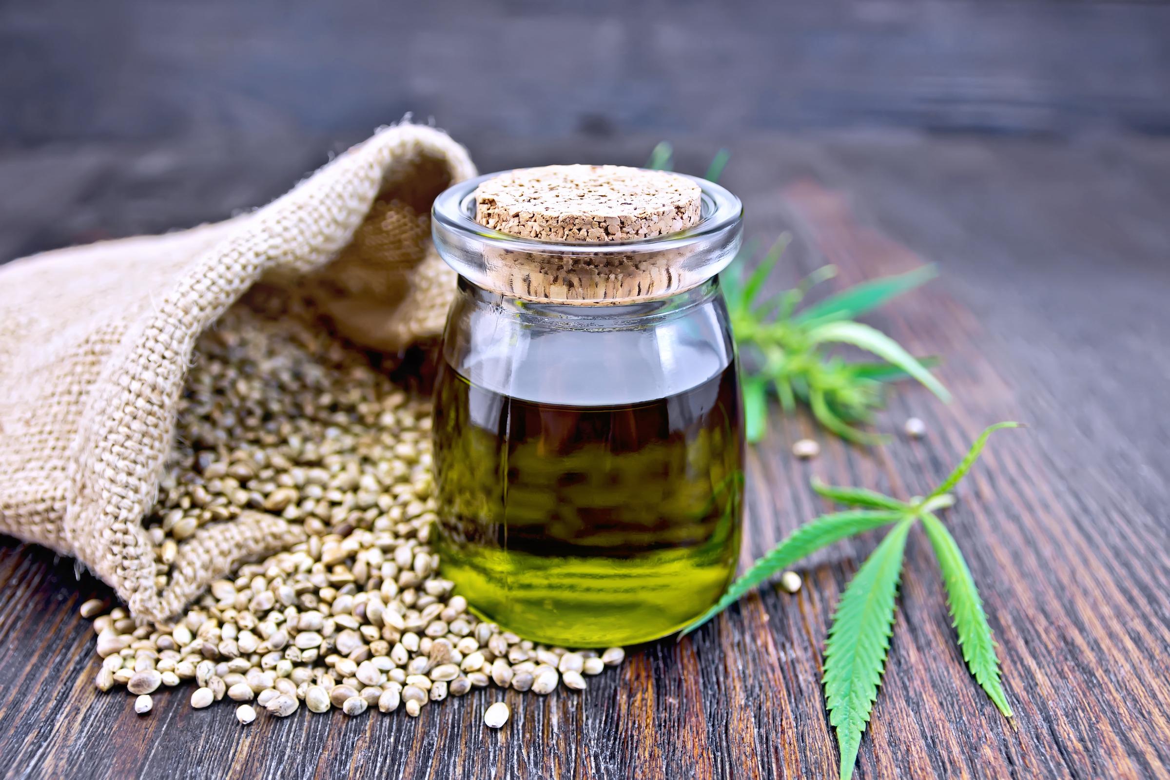 oil hemp in jar with seed in sack on board XJPFUNZ