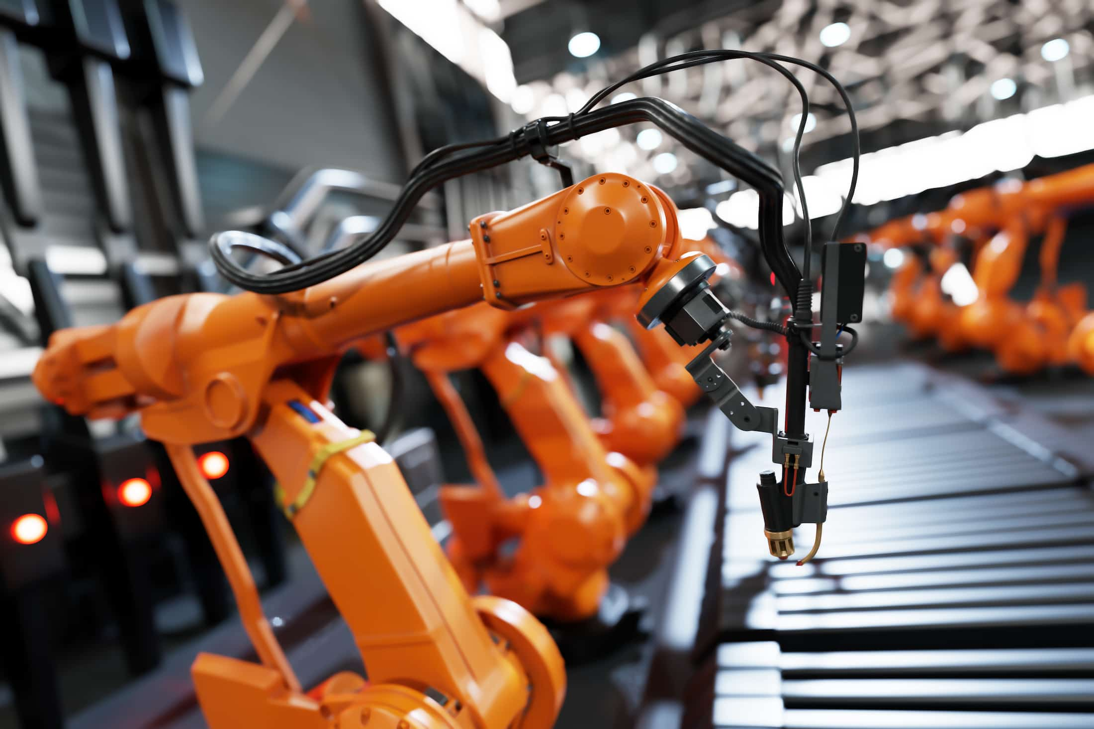 robotic arms along assembly line in modern factory QBNWXRK