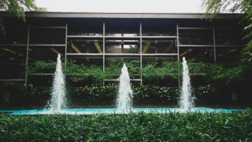 fountain and glass building