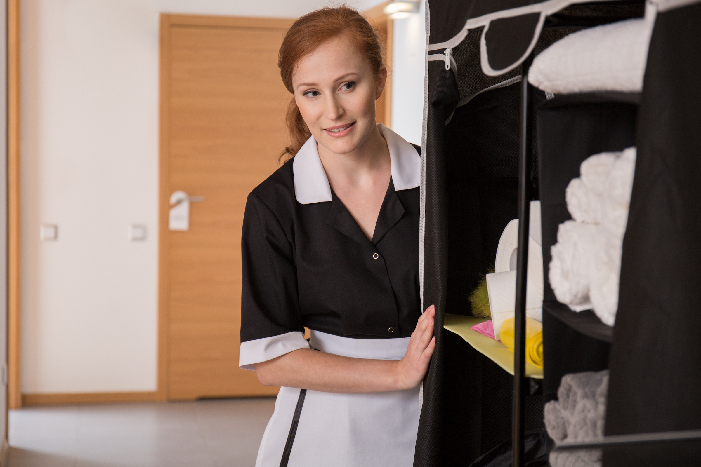 maid in uniform in corridor PUCBVDX
