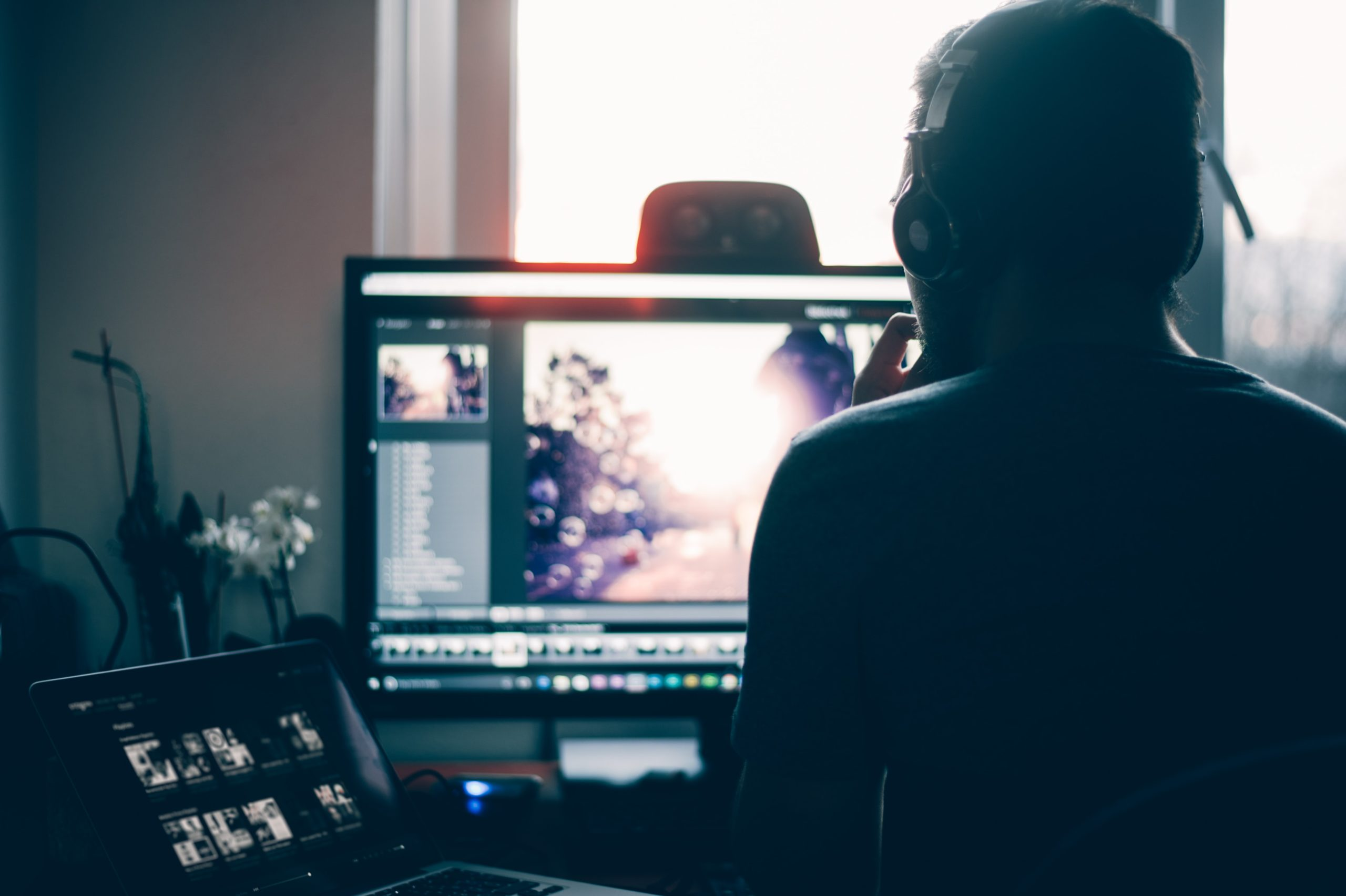 person editing photo on computer