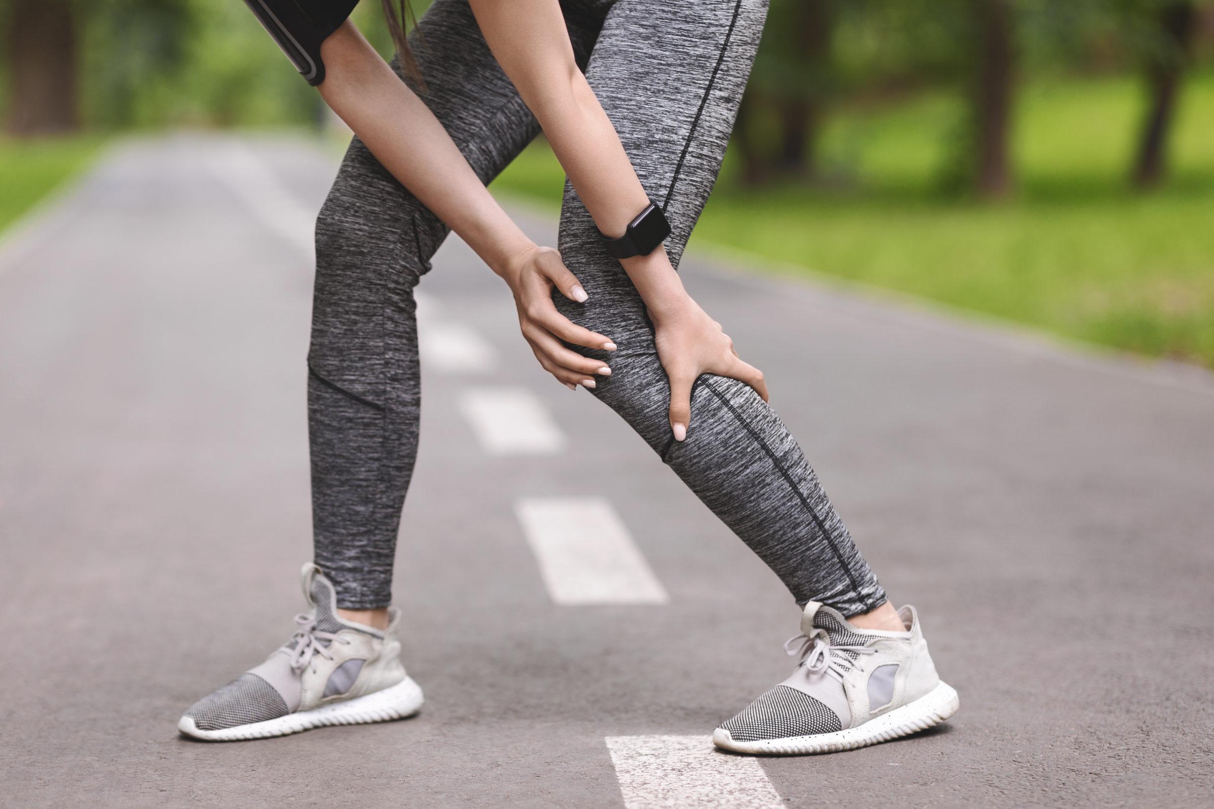 calf injury sporty woman massaging leg having musc 3WPC8X7