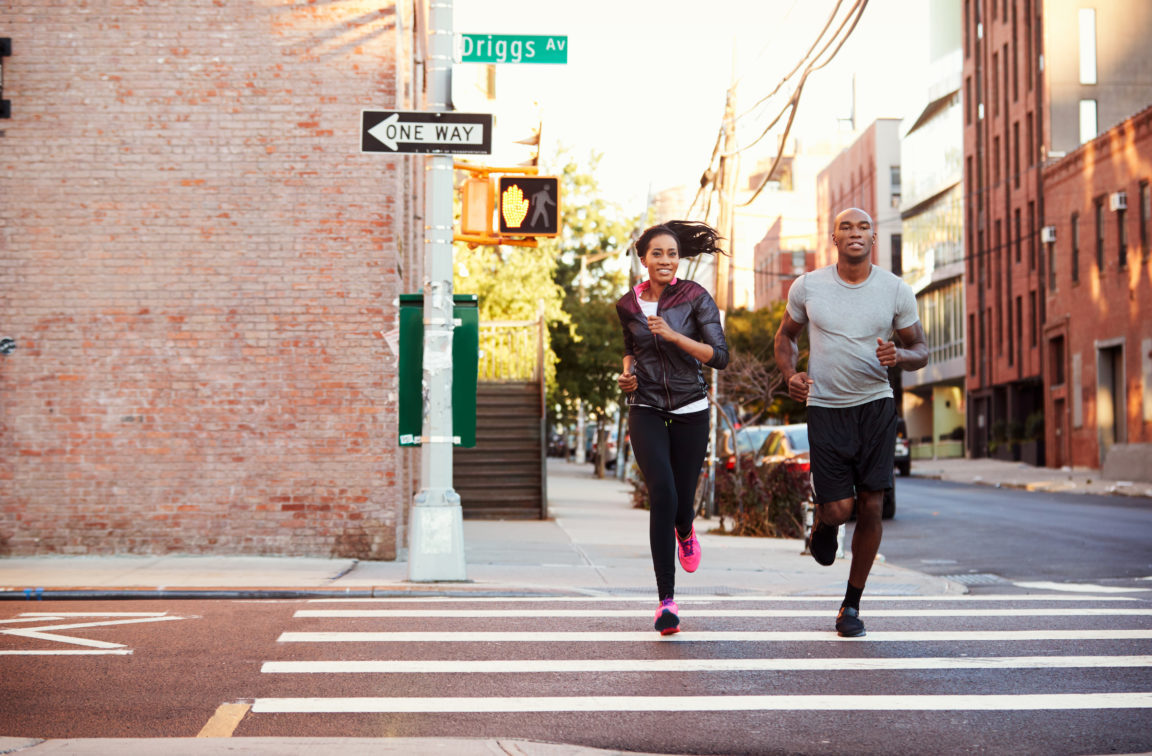 Young black couple jogging in Brooklyn street