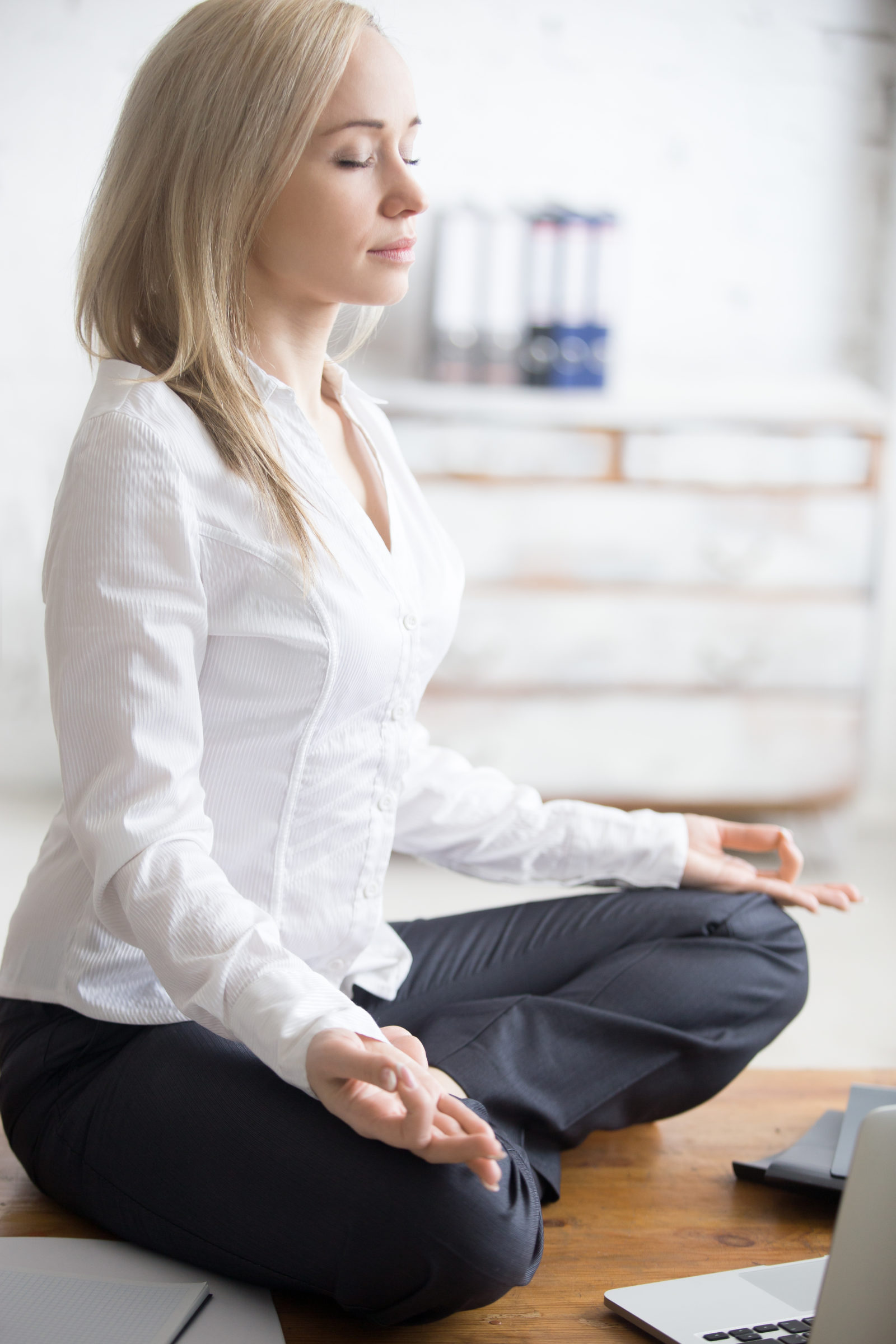 business woman sitting in padmasana pose PSTWQWD