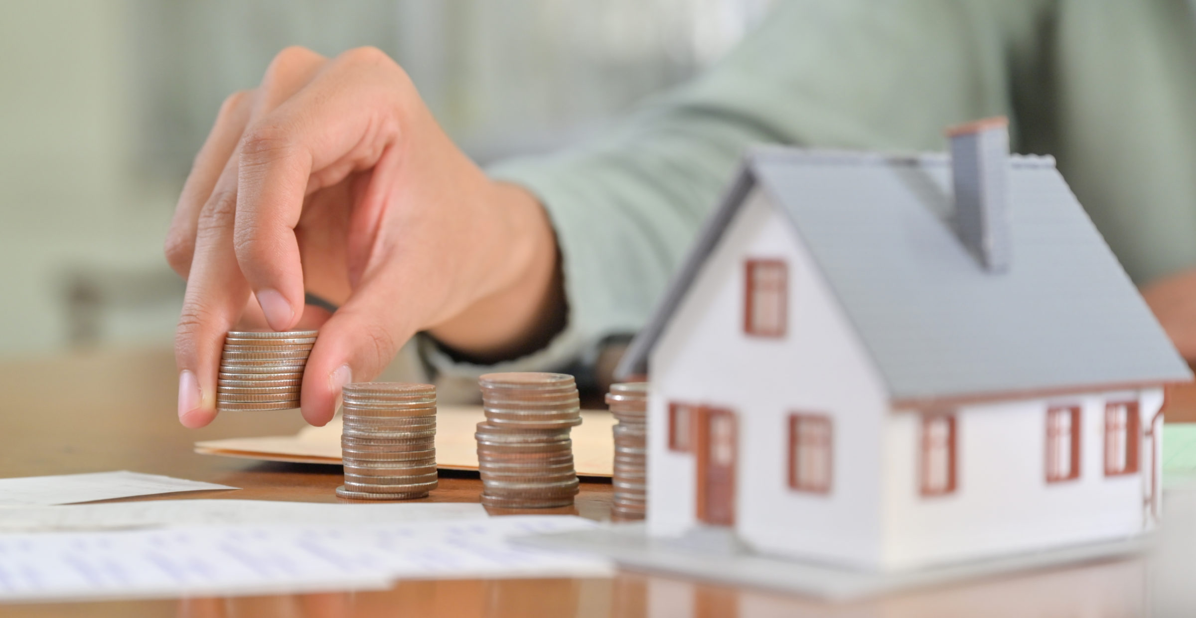 concept of saving money to buy a house D9XK23B