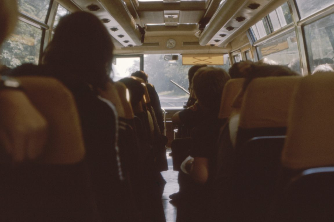 people sitting while riding bus