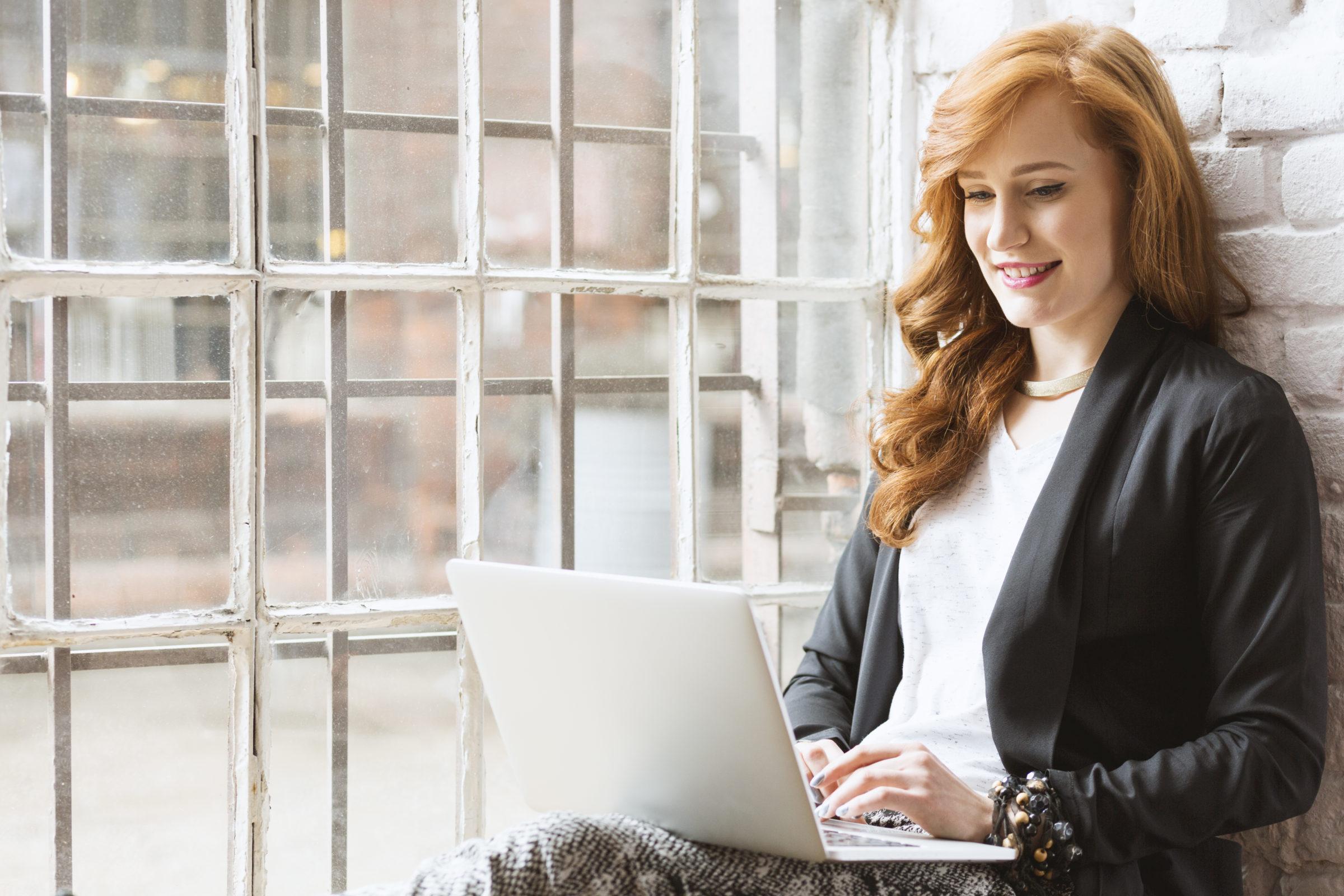 freelance copywriter sitting on windowsill PZMUTQZ