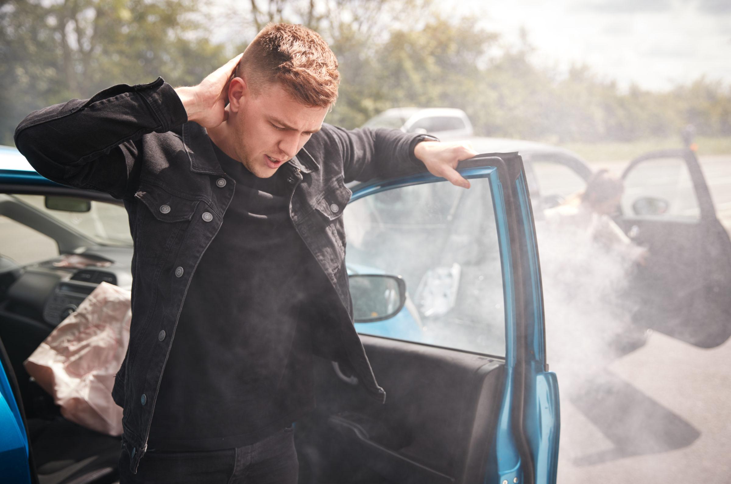 male motorist with whiplash injury in car crash ge ZR97WYQ 1