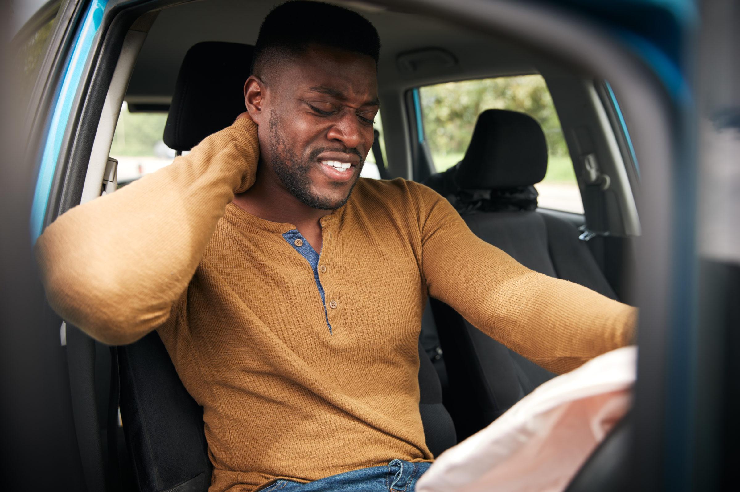 male motorist with whiplash injury in car crash wi 62GK9N8