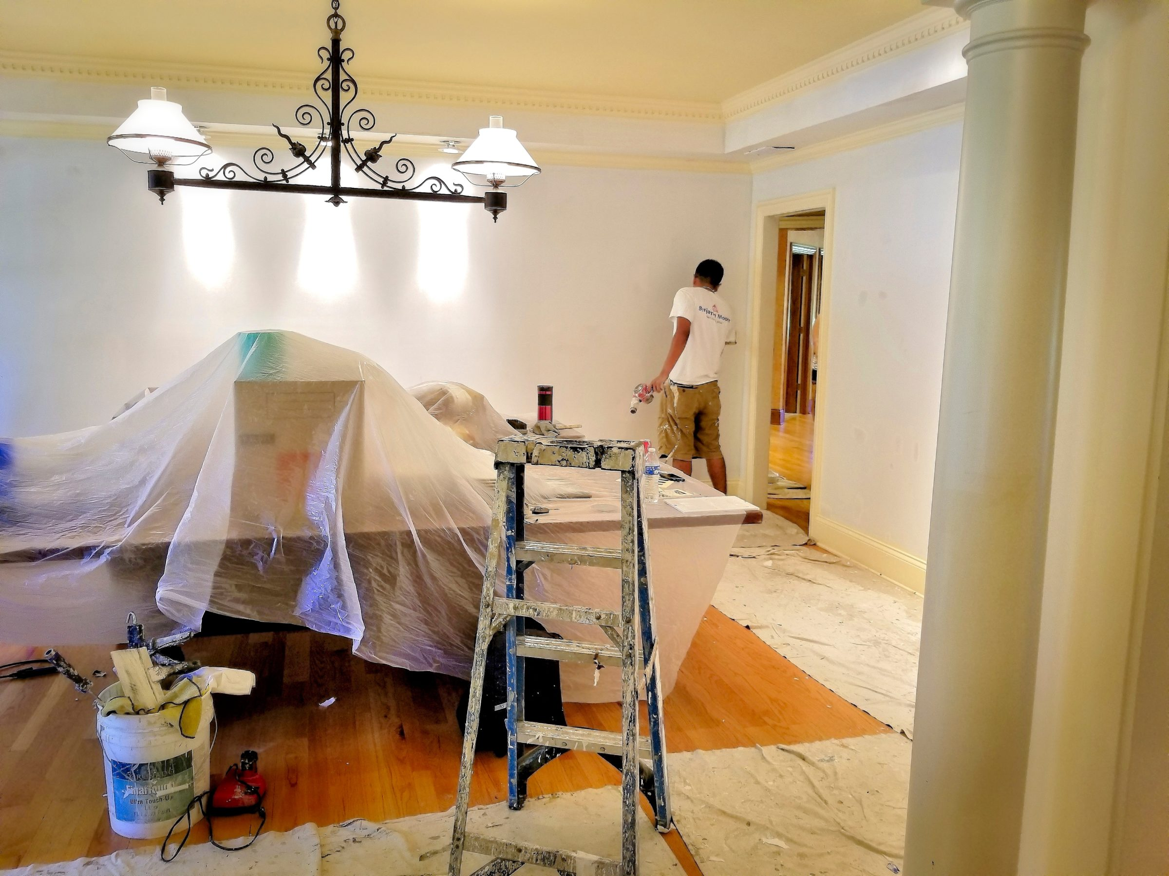 painters paint a room during a remodel VLFZMVS