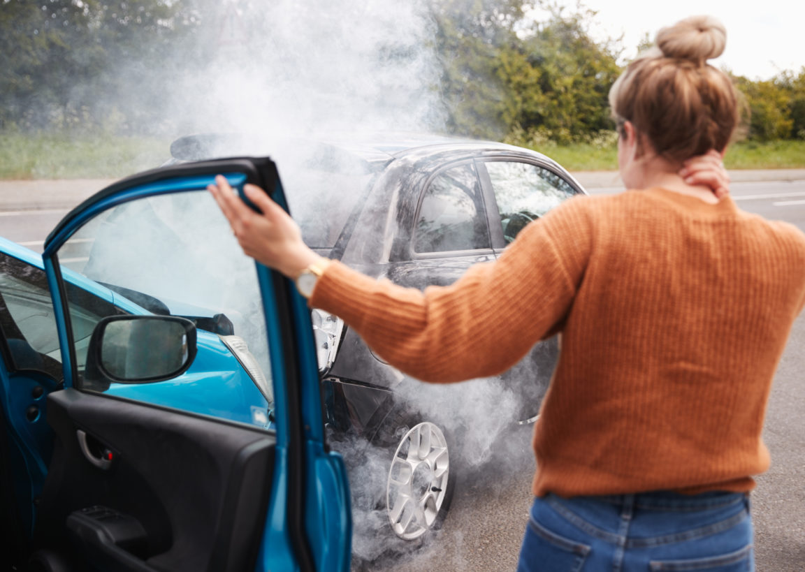 rear view of female motorist with head injury gett ZDSCTK4