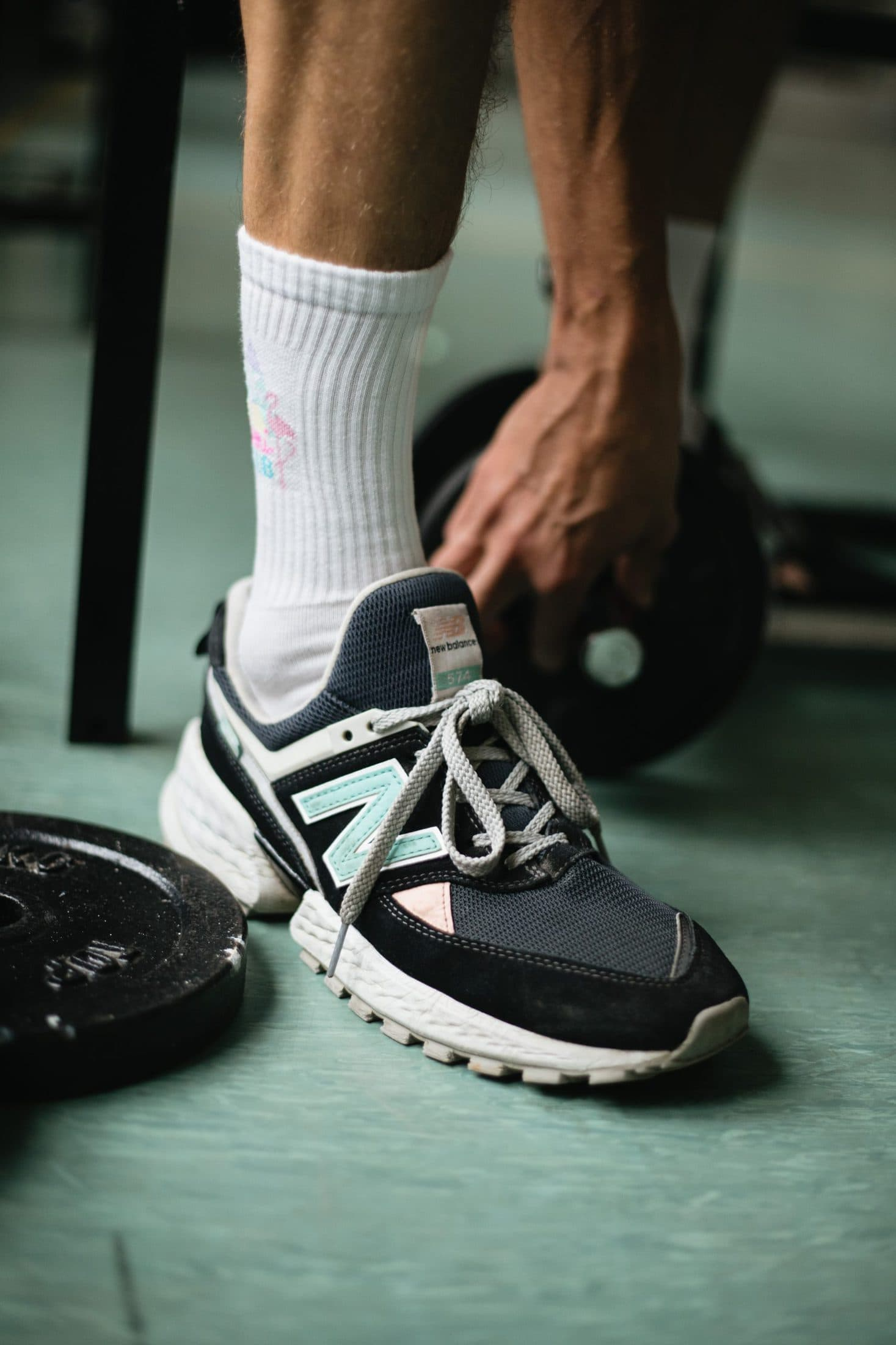 person wearing black and white new balance athletic shoes