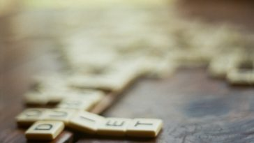 shallow focus photography of scrabble pieces