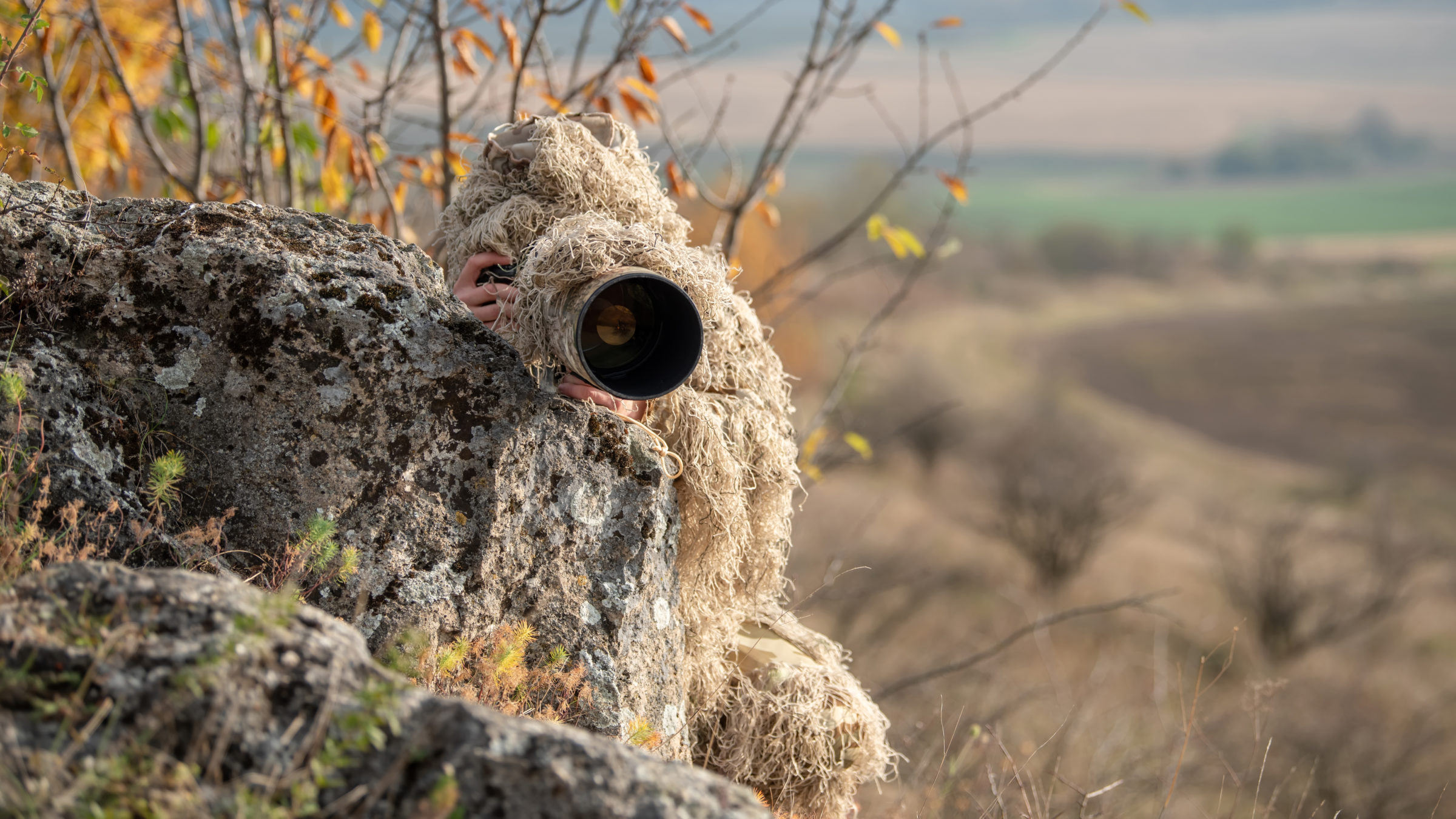 wildlife photographer in the ghillie suit working CY2458L