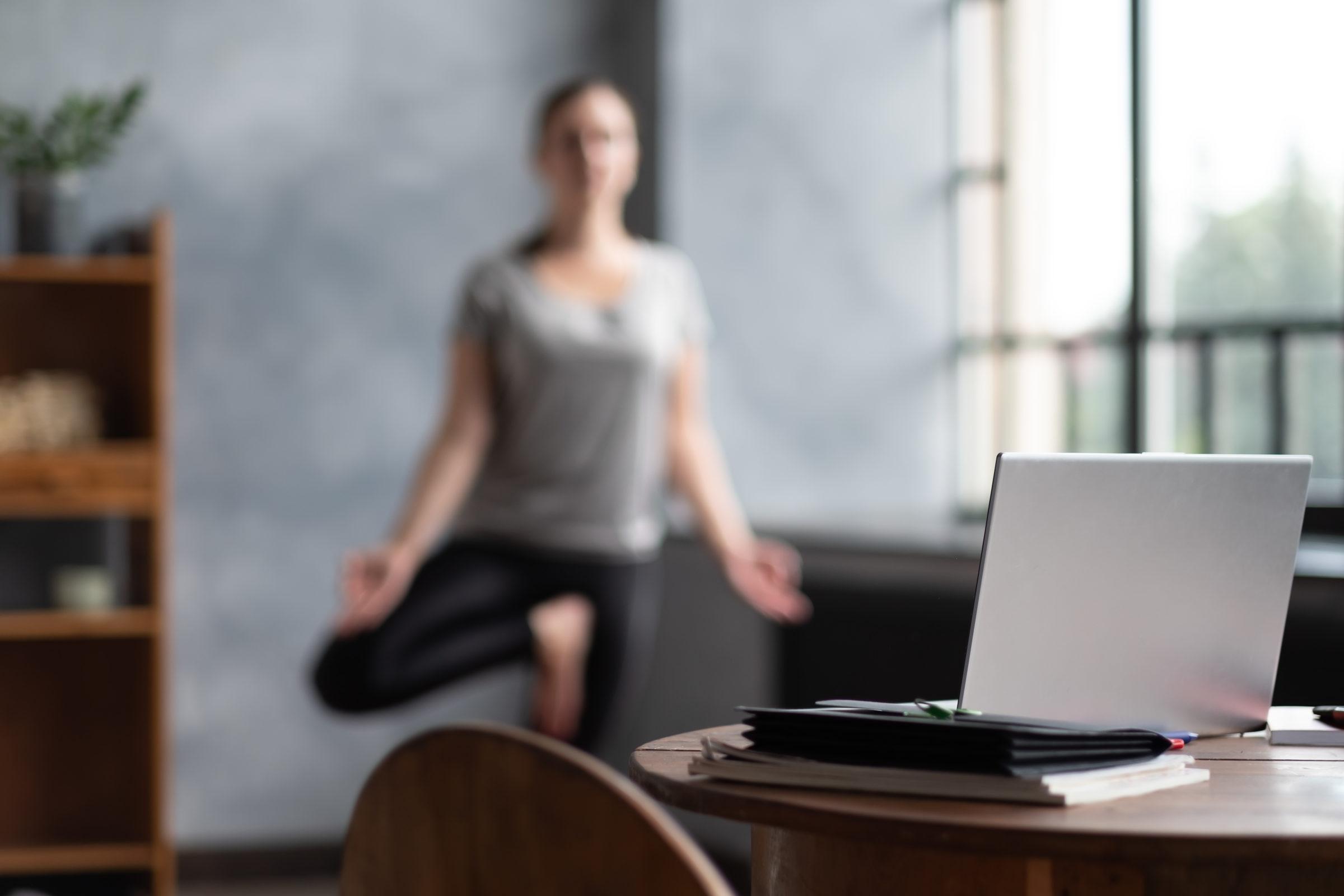 caucasian woman working yoga exercise doing balanc 9RZRT54