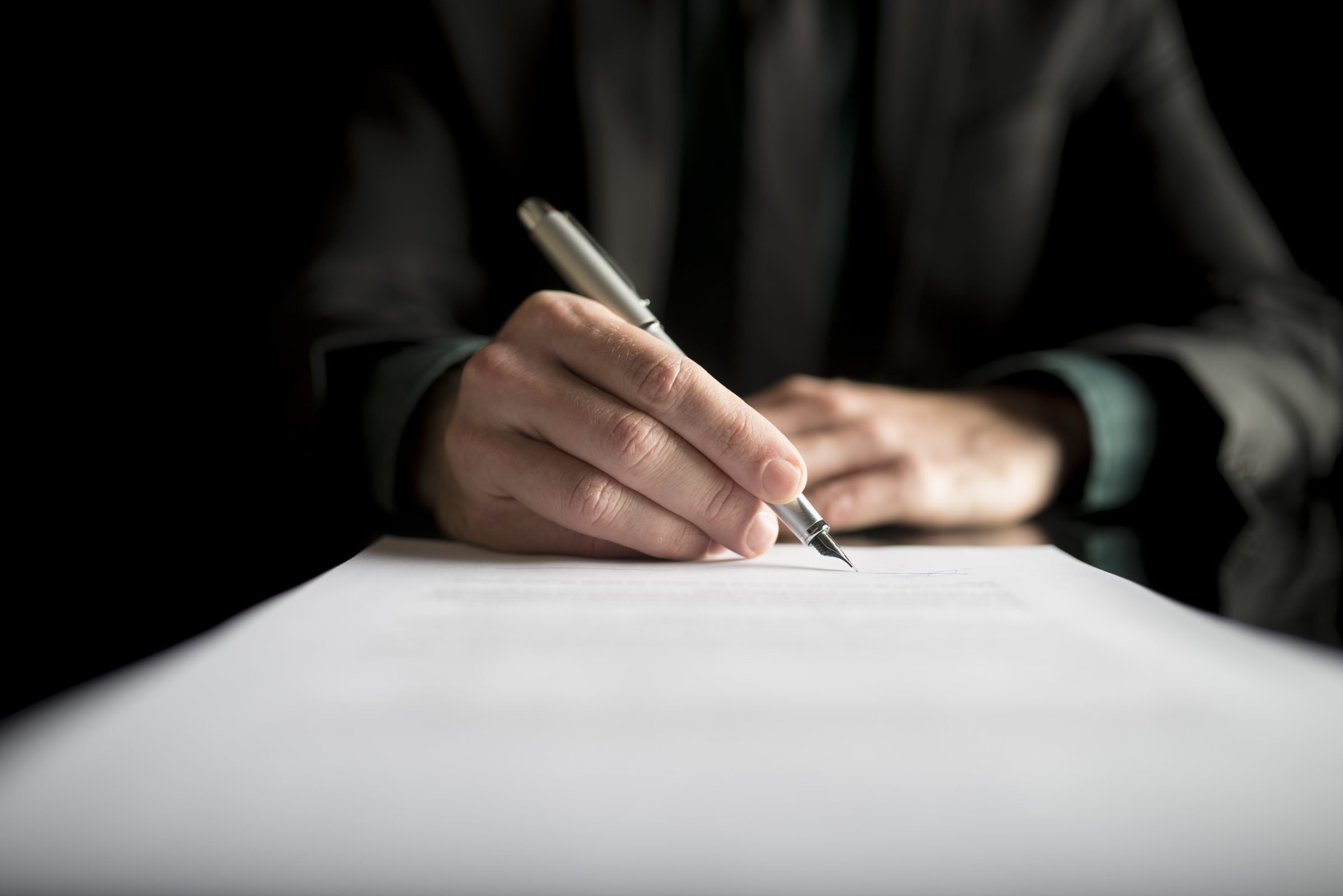 closeup of lawyer or executive signing a contract PK4B783