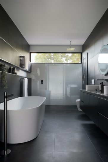 white ceramic bathtub near white bathtub