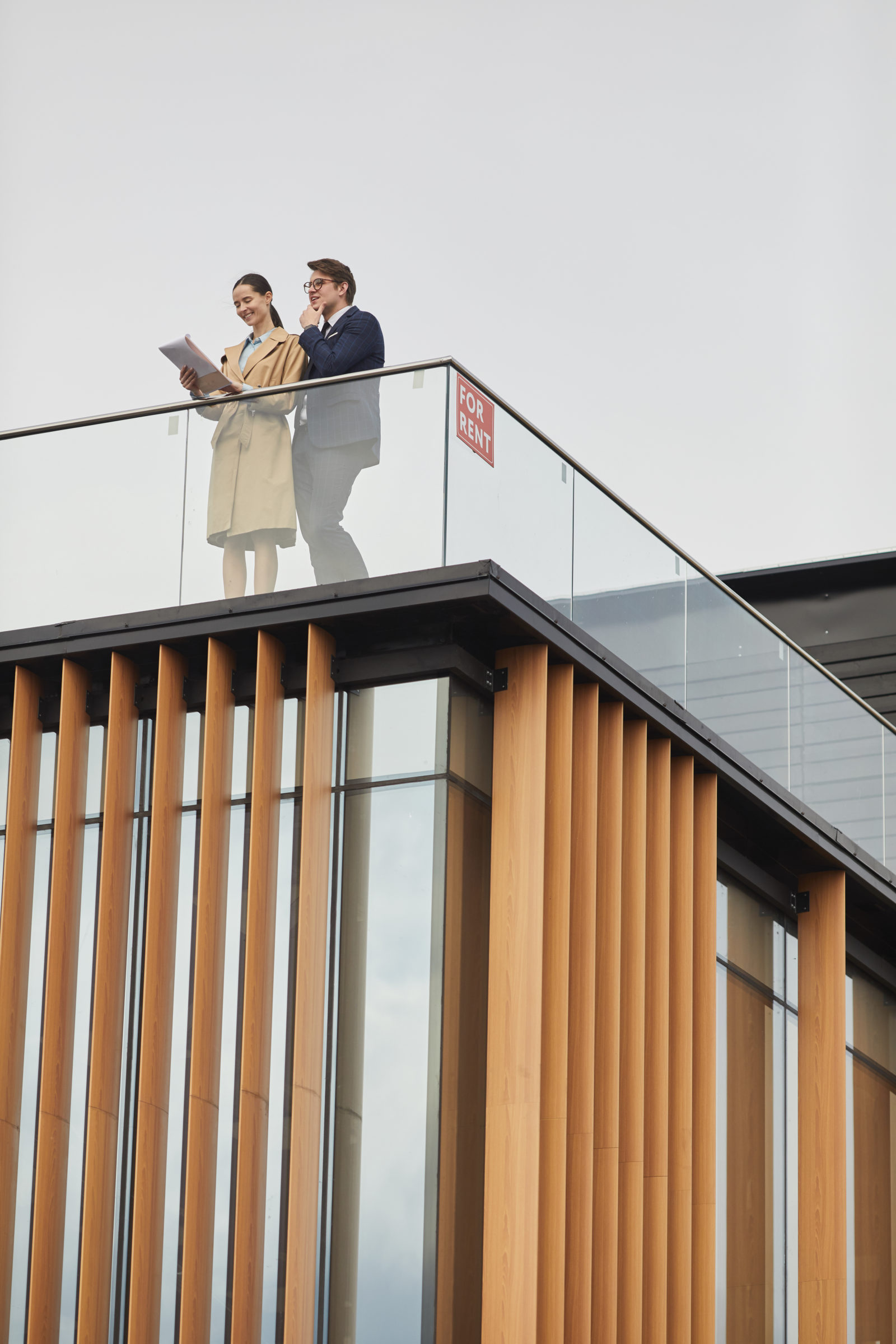 two real estate agents standing on roof XEUEX3T