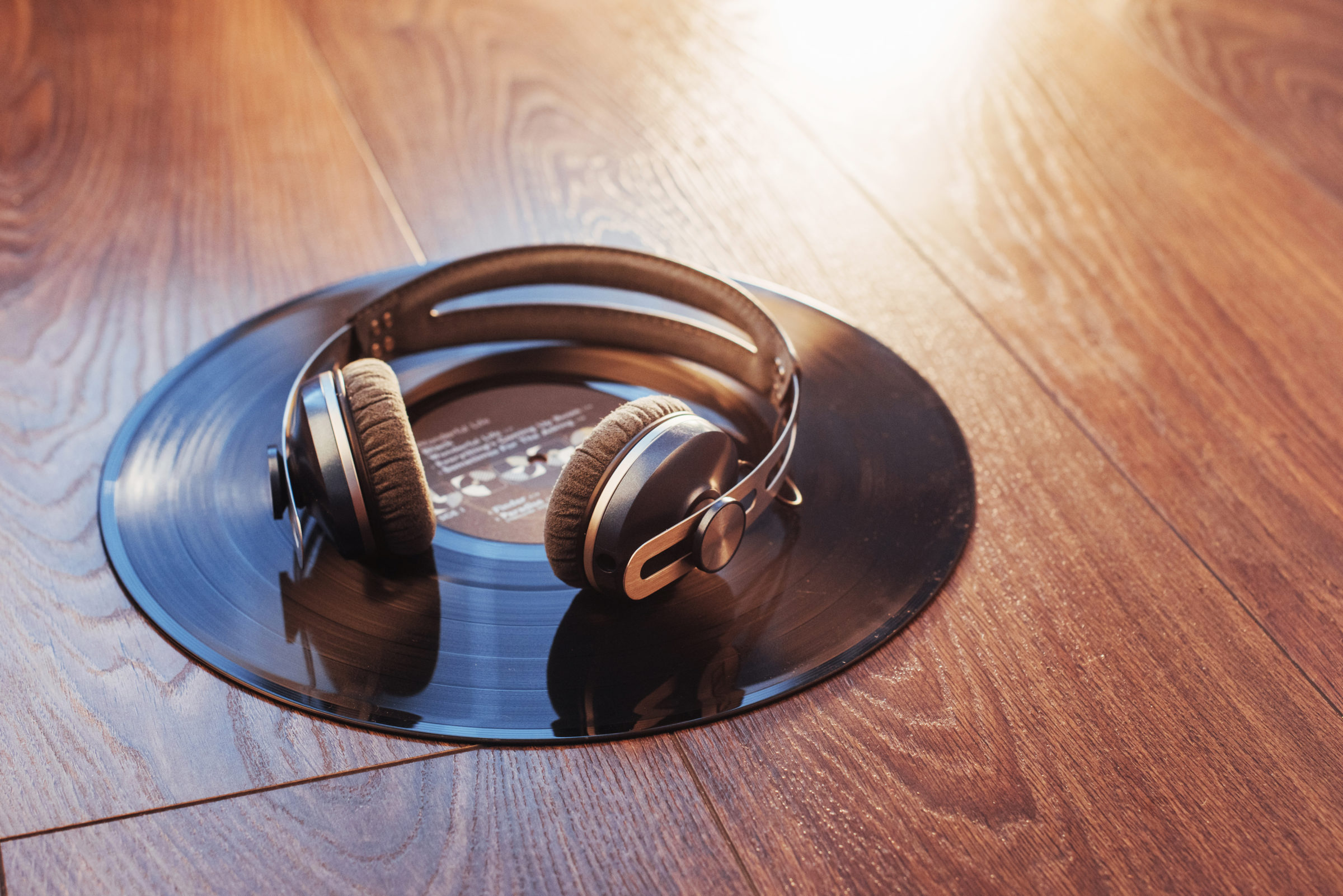 vinyl record and headphone over wooden table audio HJB44PW