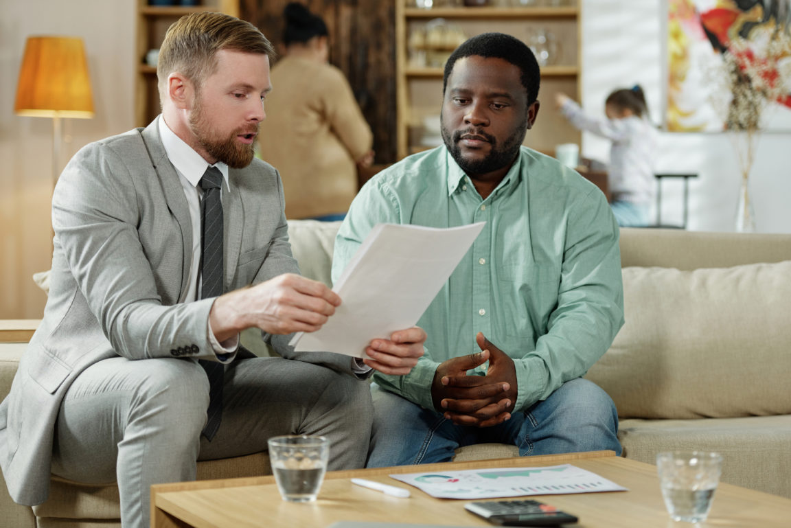 black man with consultant on mortgage LY3ZXGB