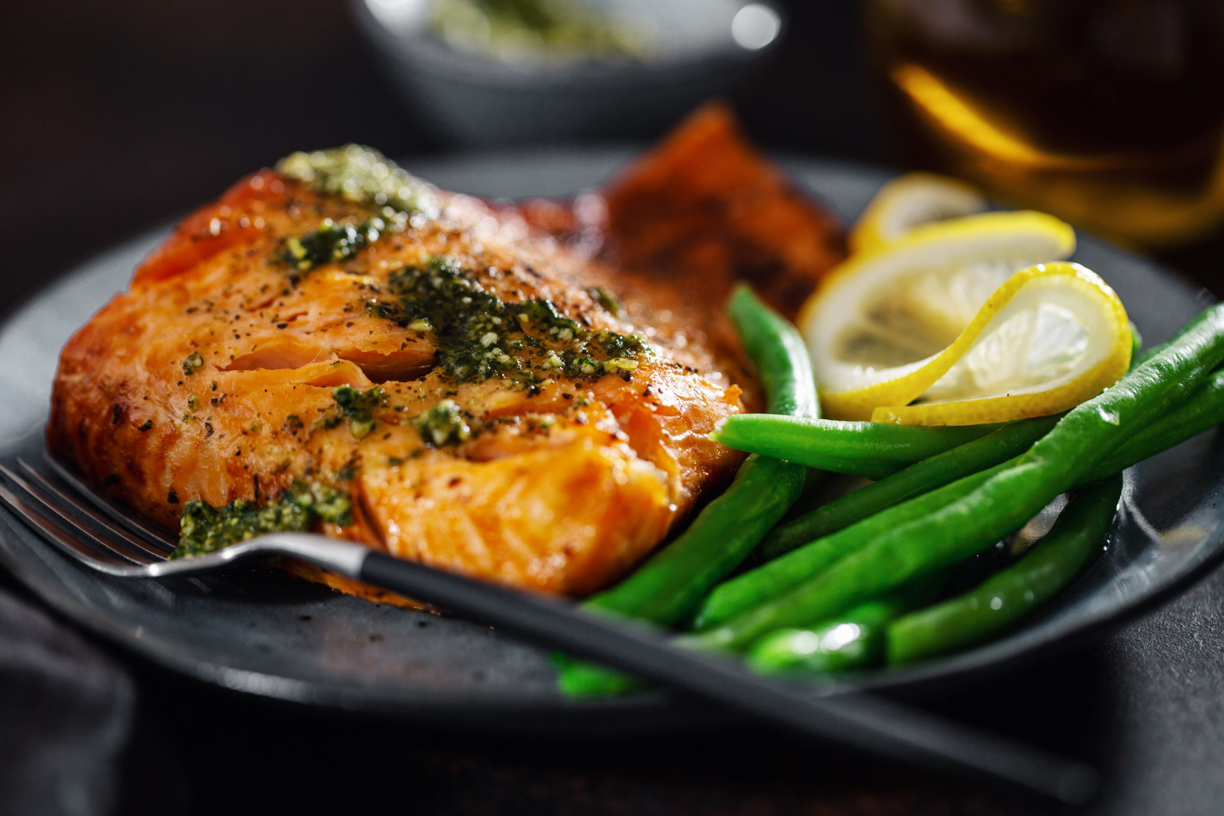 closeup of baked salmon fish with green beans 63WKC3S 1