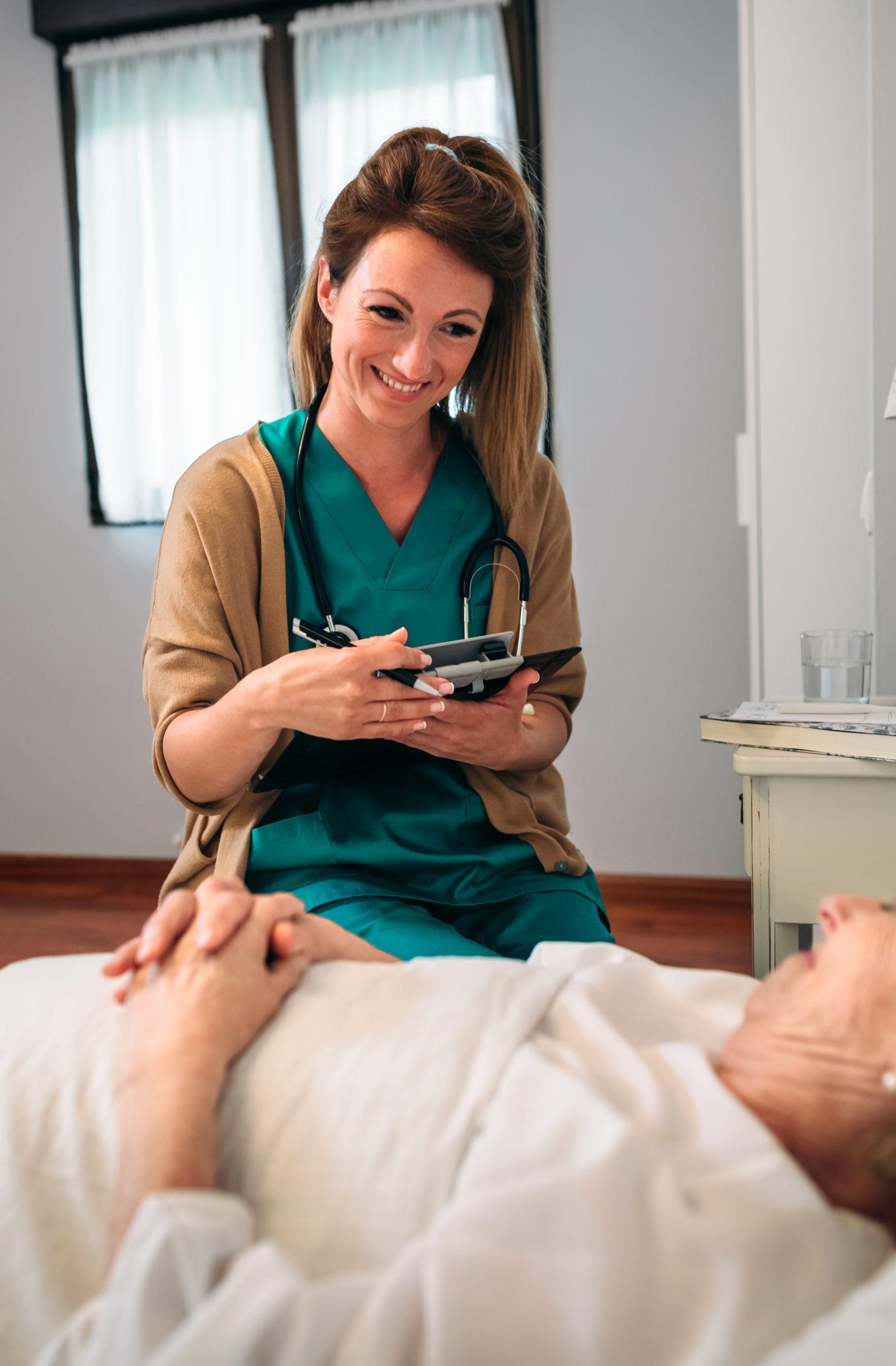 female doctor comforting older patient RDKMH5V