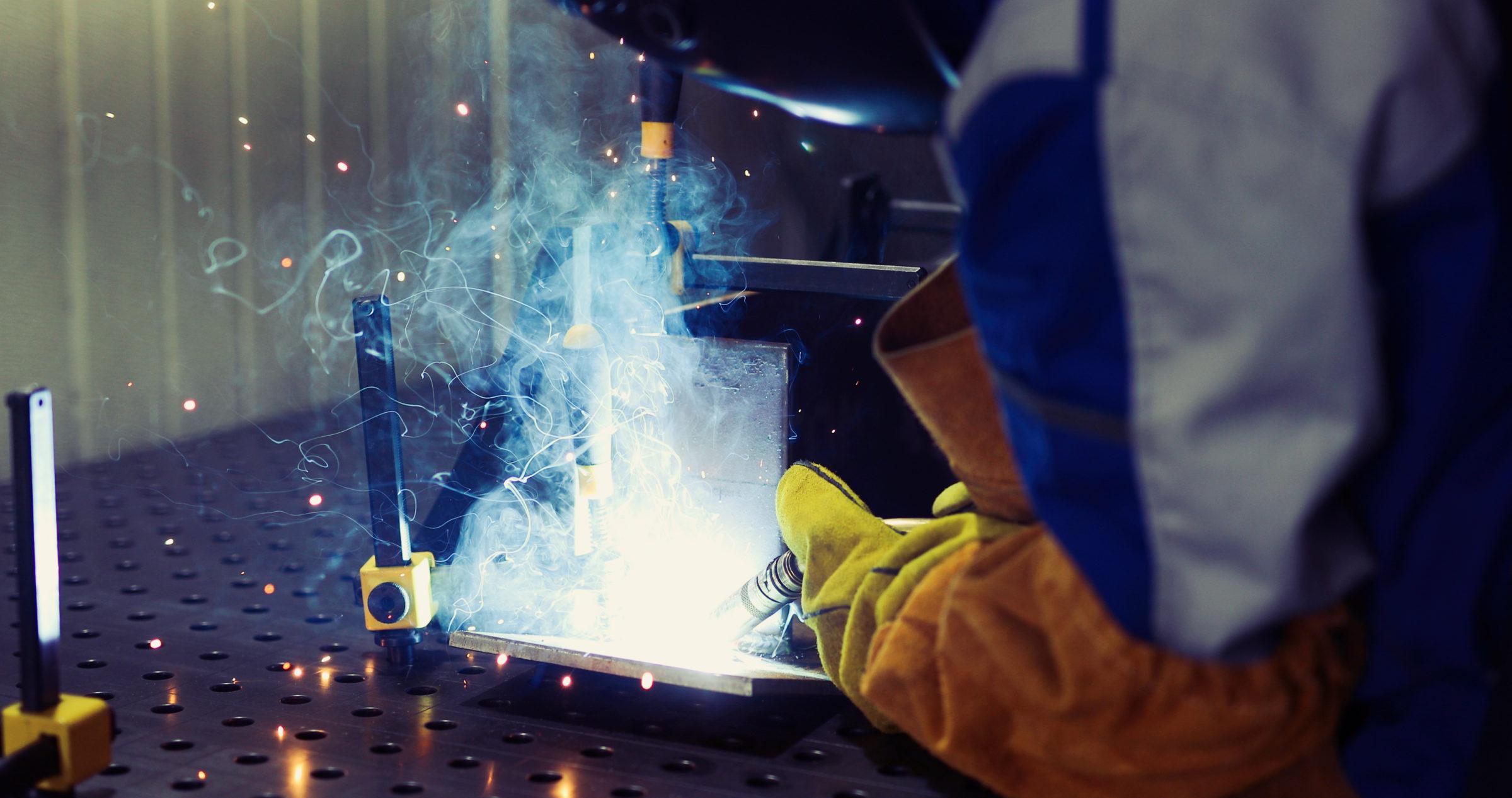 metal worker welding in metal industry factory FG8ZMSC
