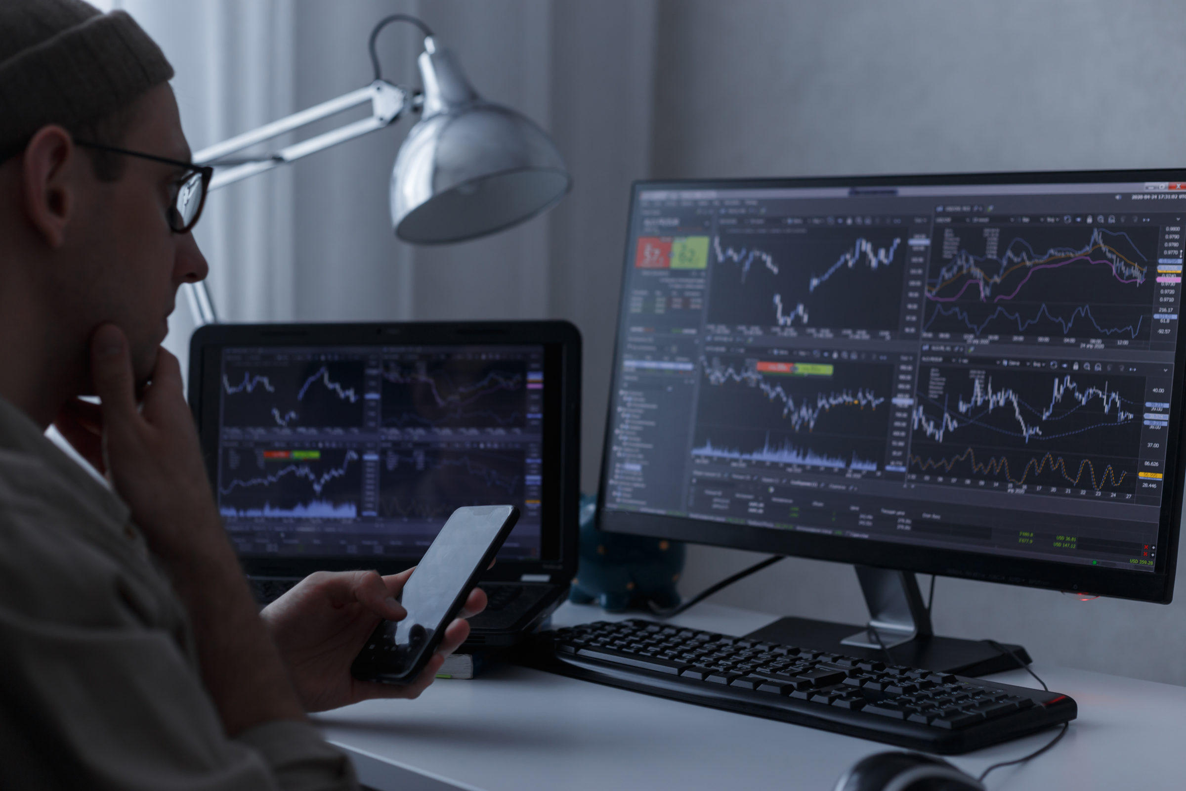trader analysing financial graph and stock statist LXBXR79