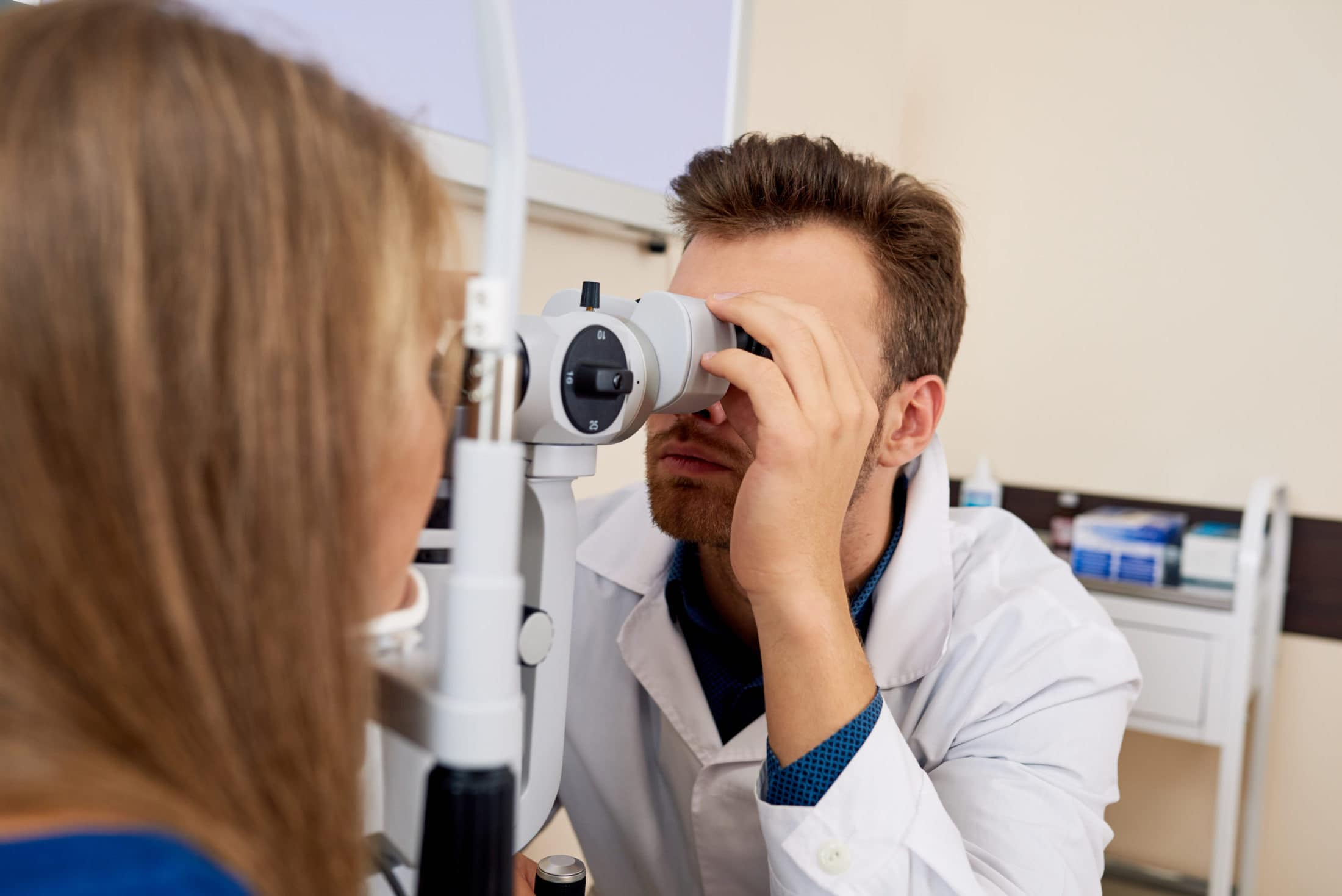 young woman getting eye test at optometrists XT46GCA scaled