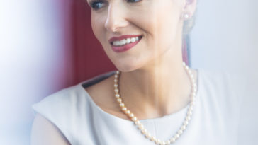 elegant woman wearing pearl jewelry P3RL8LX