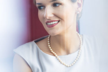 elegant woman wearing pearl jewelry P3RL8LX