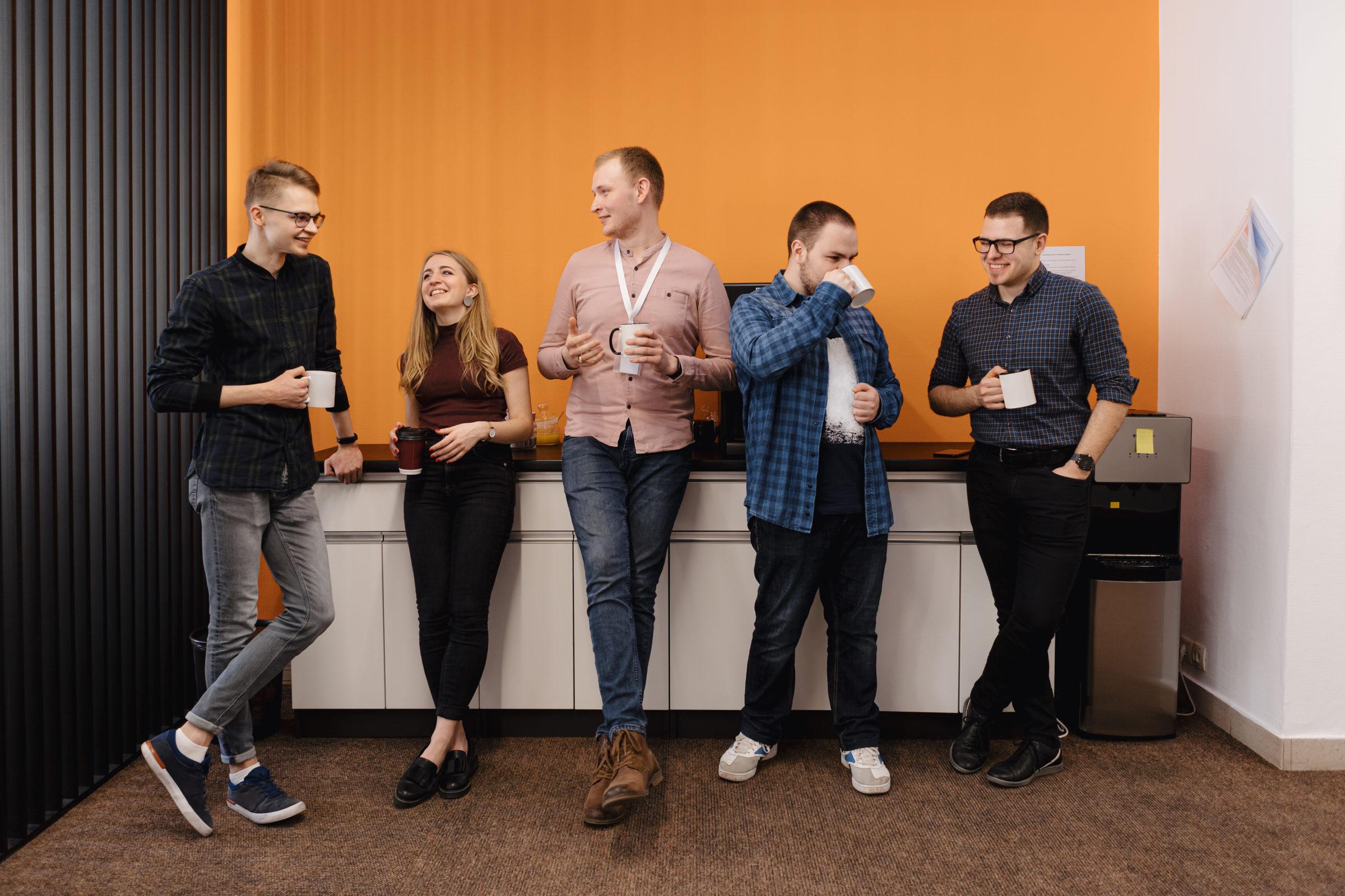 group of coworkers having a coffee break QGMSM8H