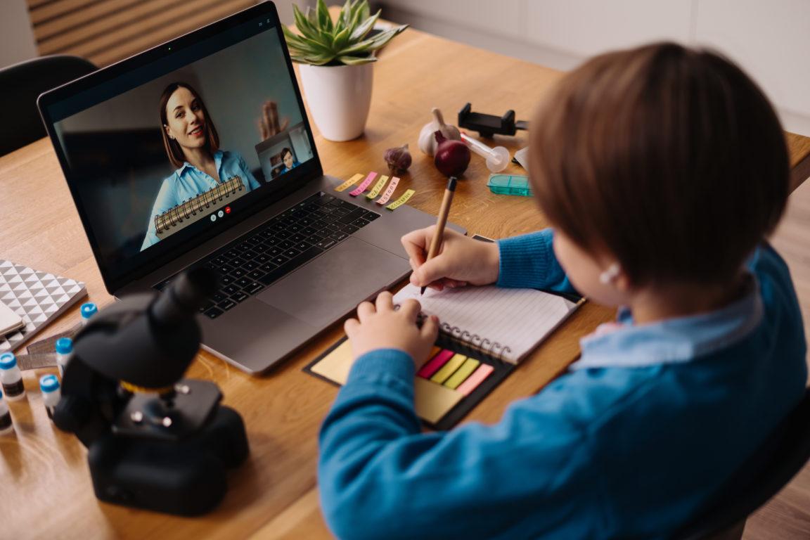 online learning using laptop teacher and boy GEKHYKV