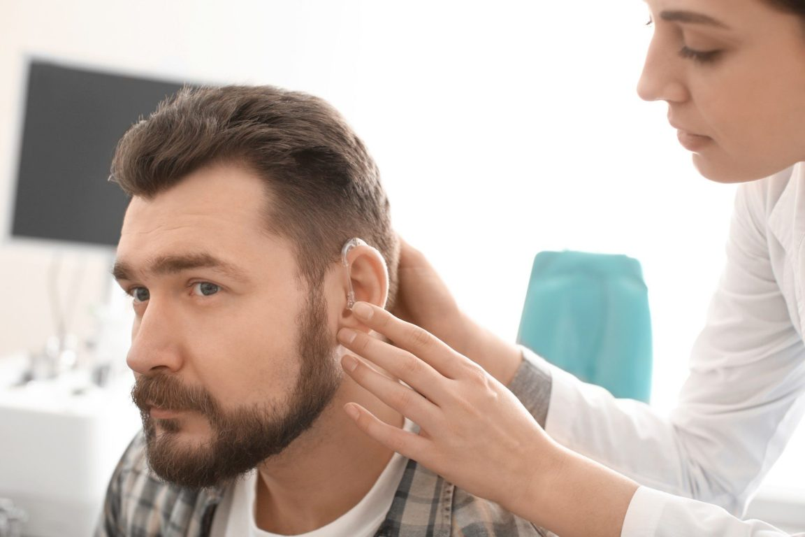 veteran being fitted for hearing aid.jpg.optimal
