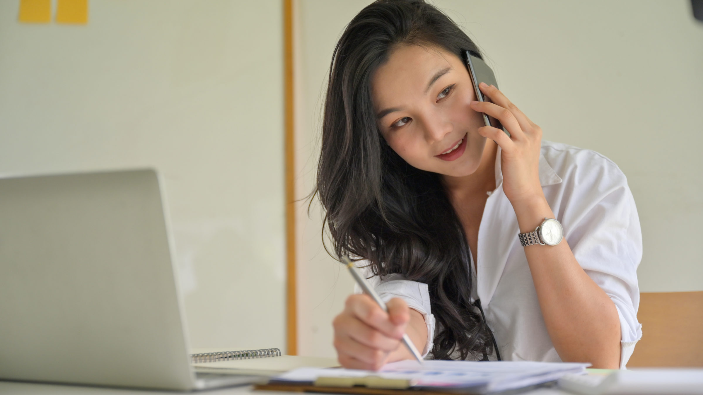 young business women on the phone to coordinate in B6T3FZF