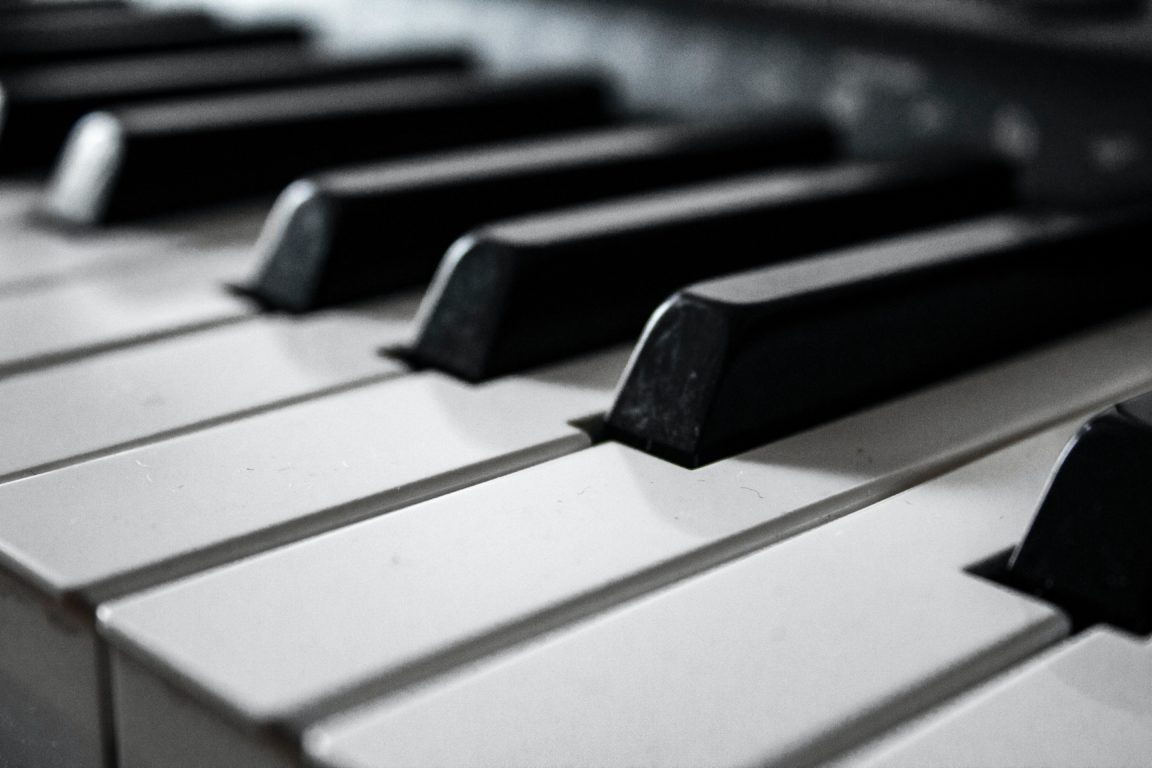 grayscale photography of piano