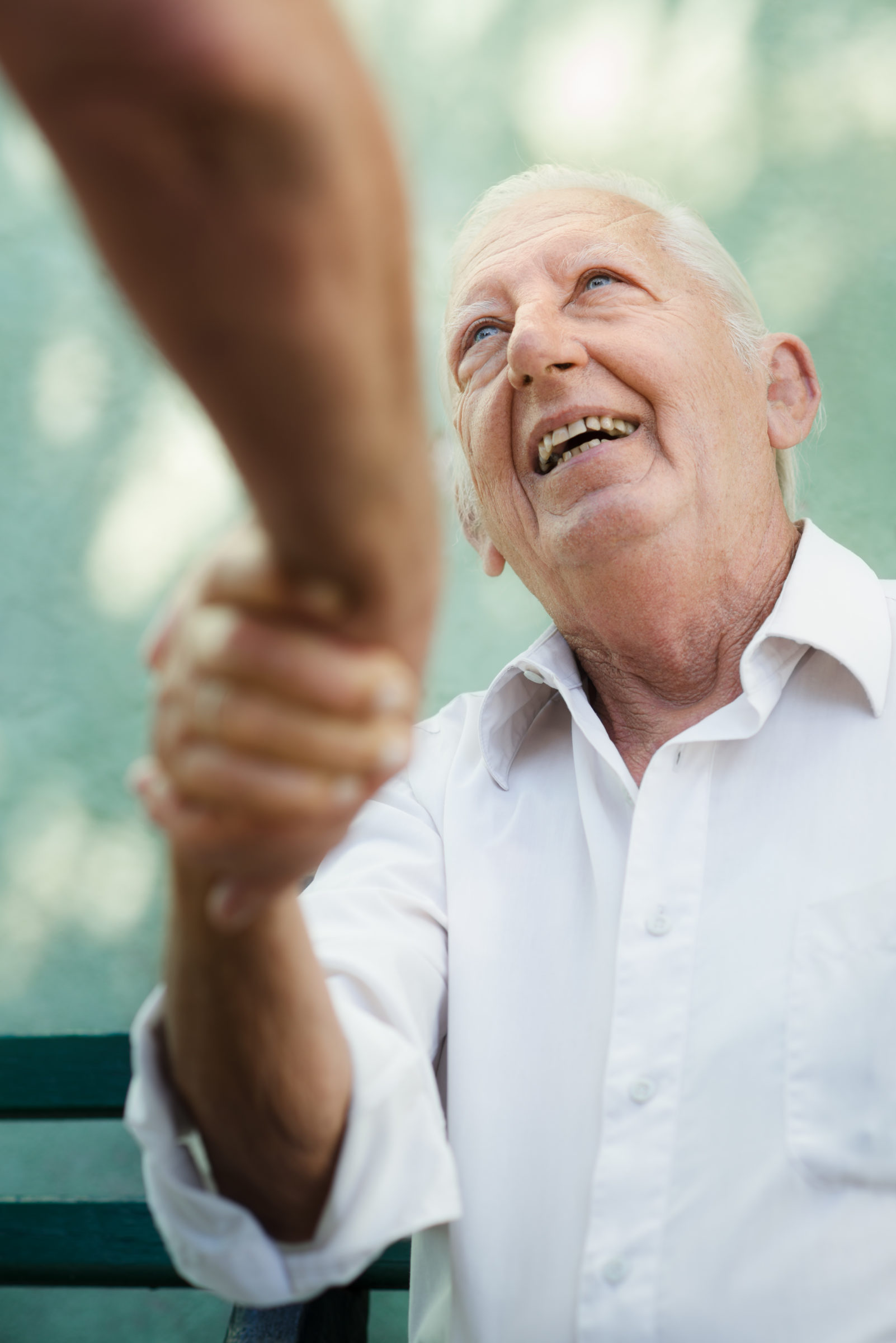 group of happy elderly men laughing and talking PR2XX8T