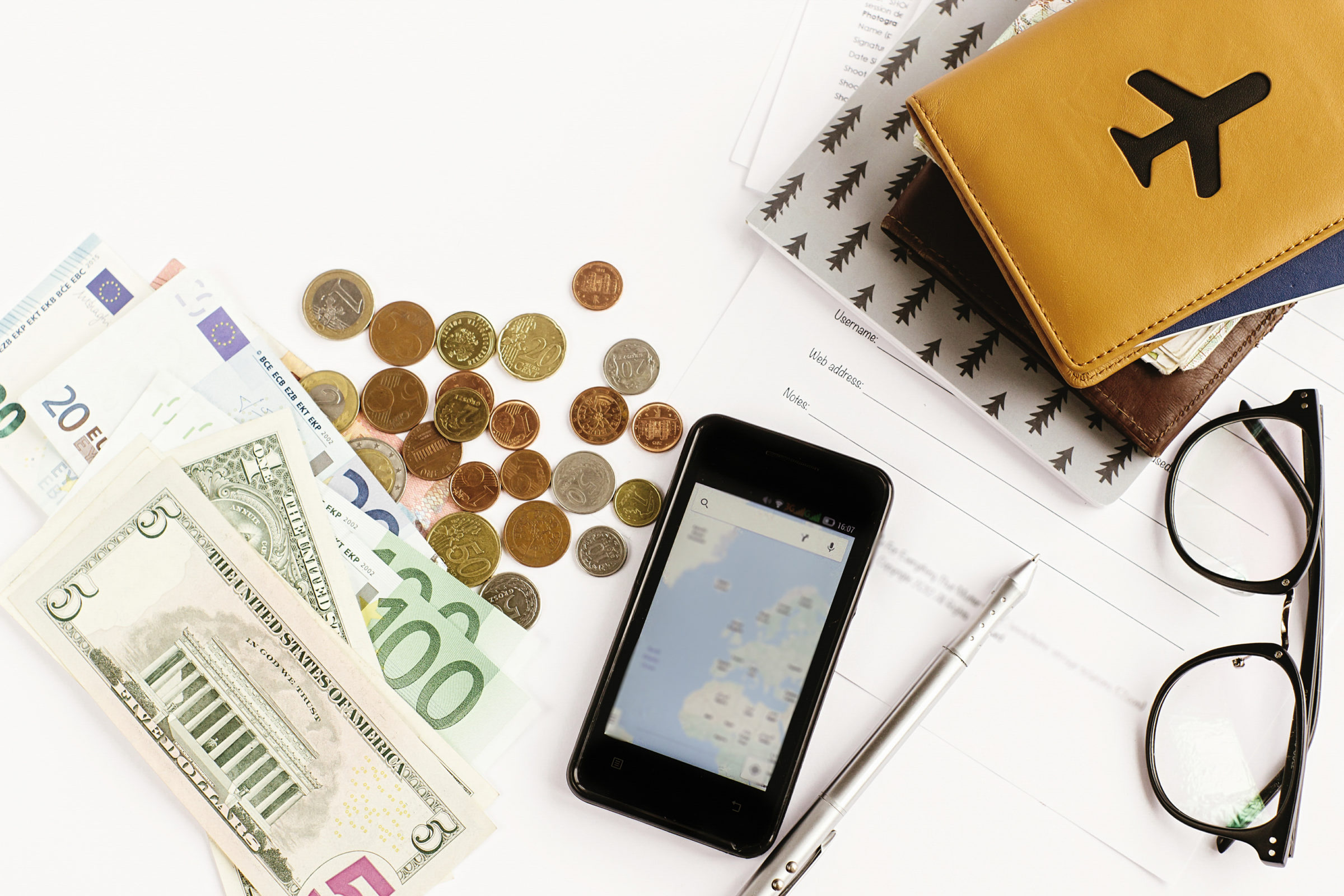 passport money phone with map and glasses GX2N3CN