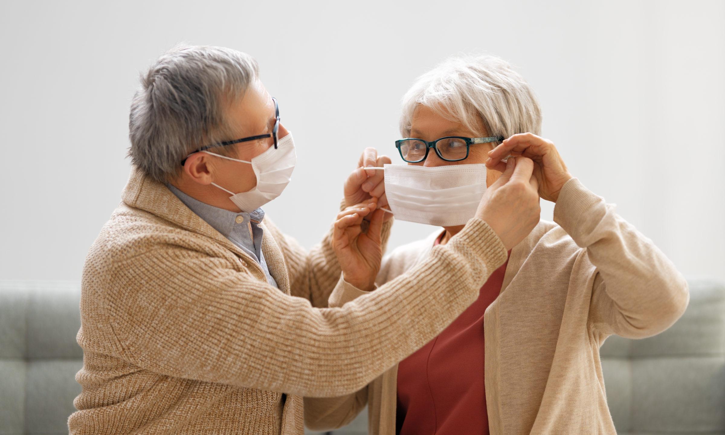 senior couple wearing facemasks XXJUQAE