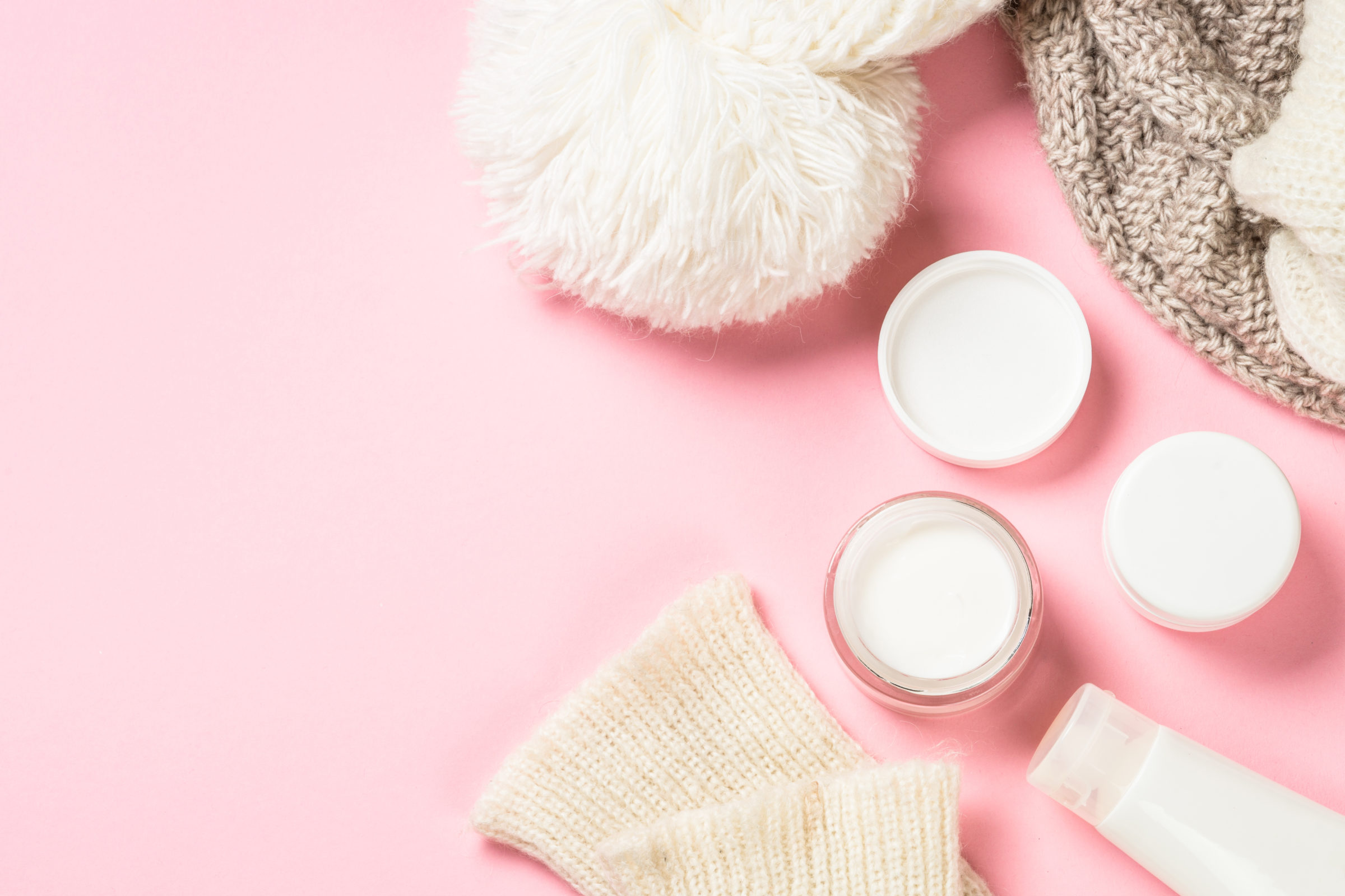 winter cream for skin on pink top view 78TMUQX