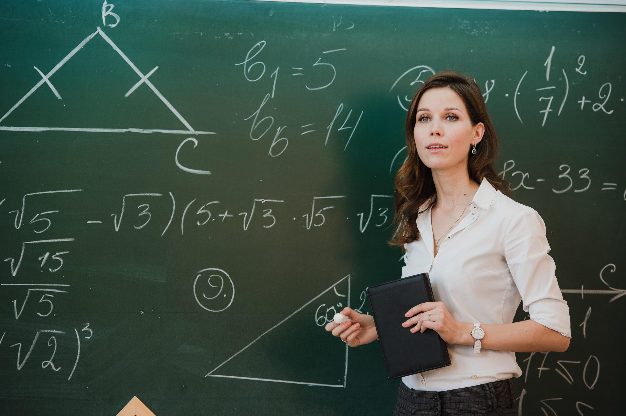 young attractive female teacher of maths interacti J5DGX64
