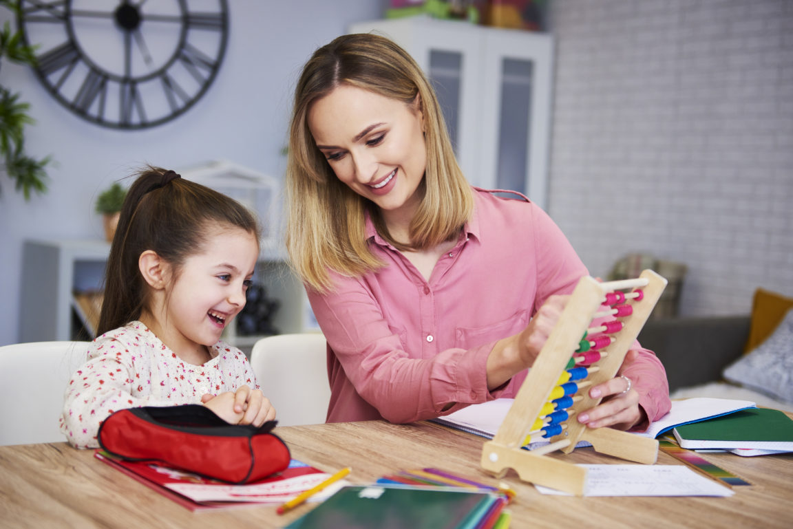 young mother and child studying at home DZEXX2Q