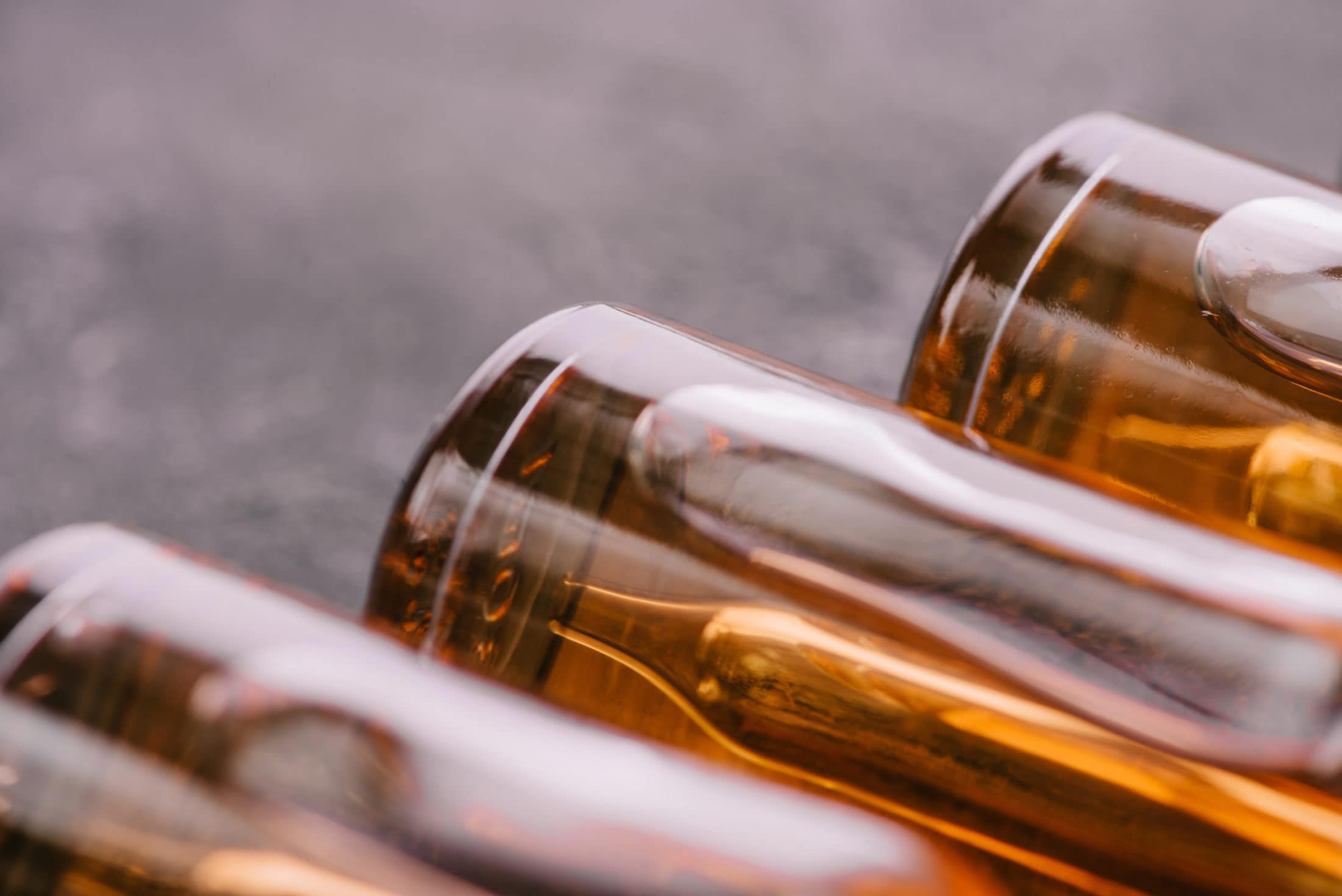 close up of bottles with cbd oil on grey backgroun L7L5CHF scaled