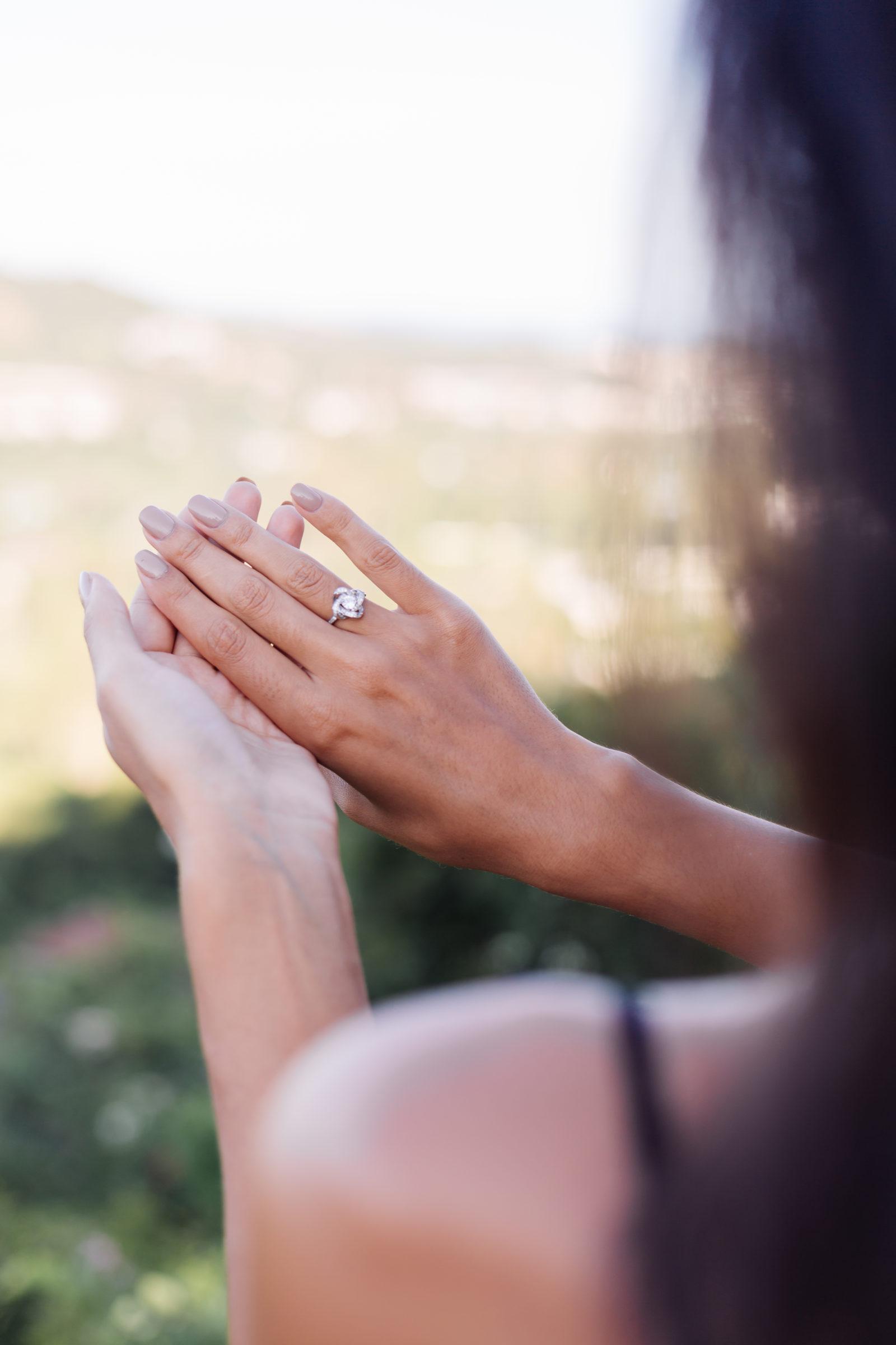 close up of elegant diamond ring on woman finger w VWGMXCC