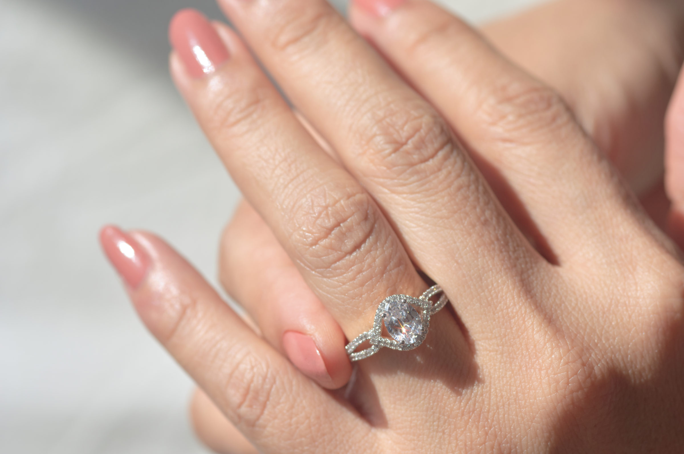 close up view of diamond ring and woman hand 3MEDSGP