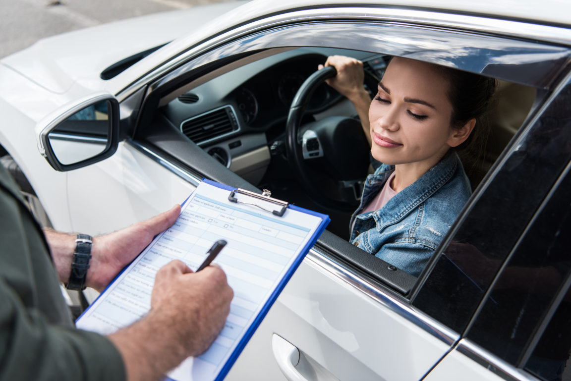cropped image of driver waiting while man writing JVZSWF5
