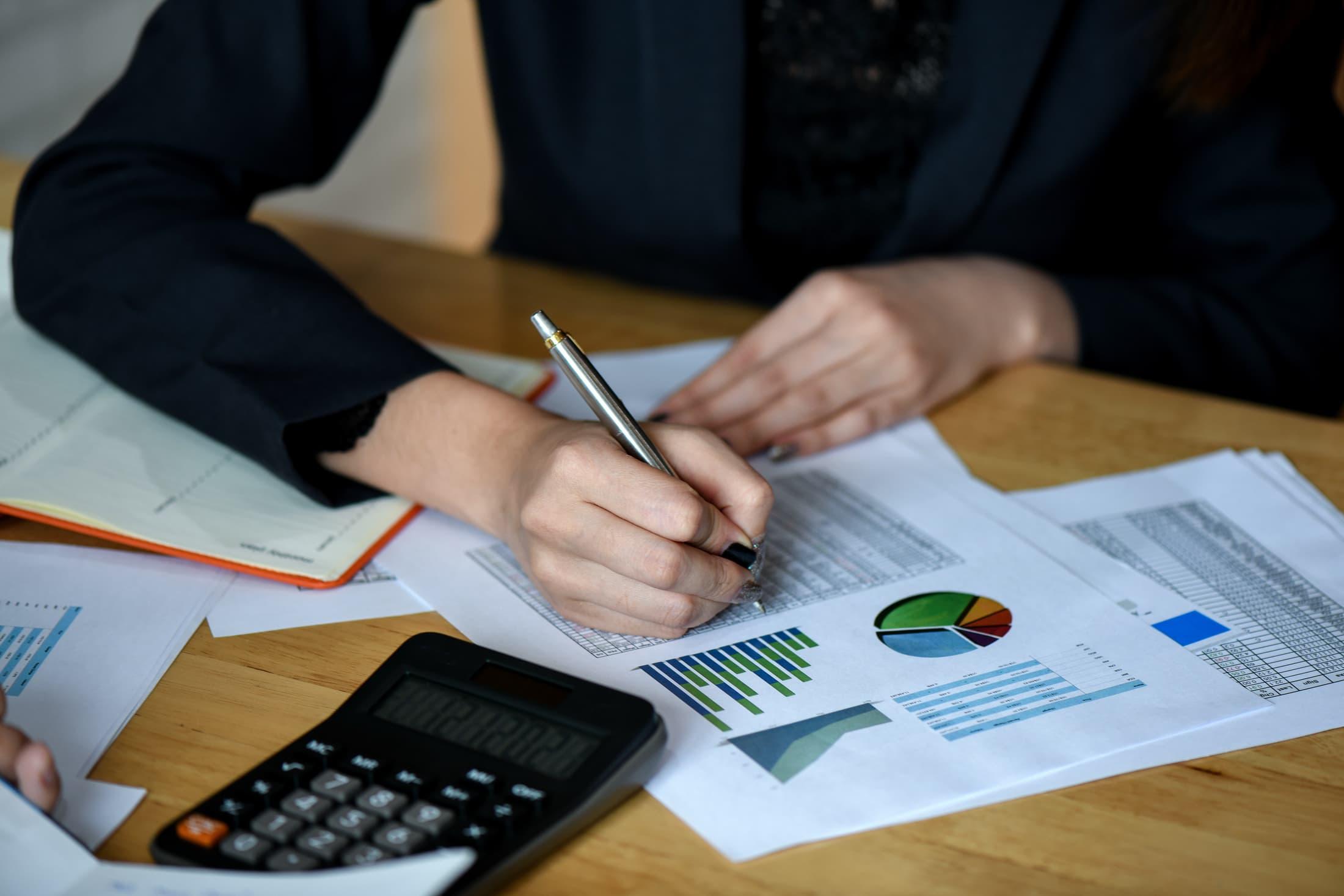 office staff analyze marketing data on the office LYP9AWU